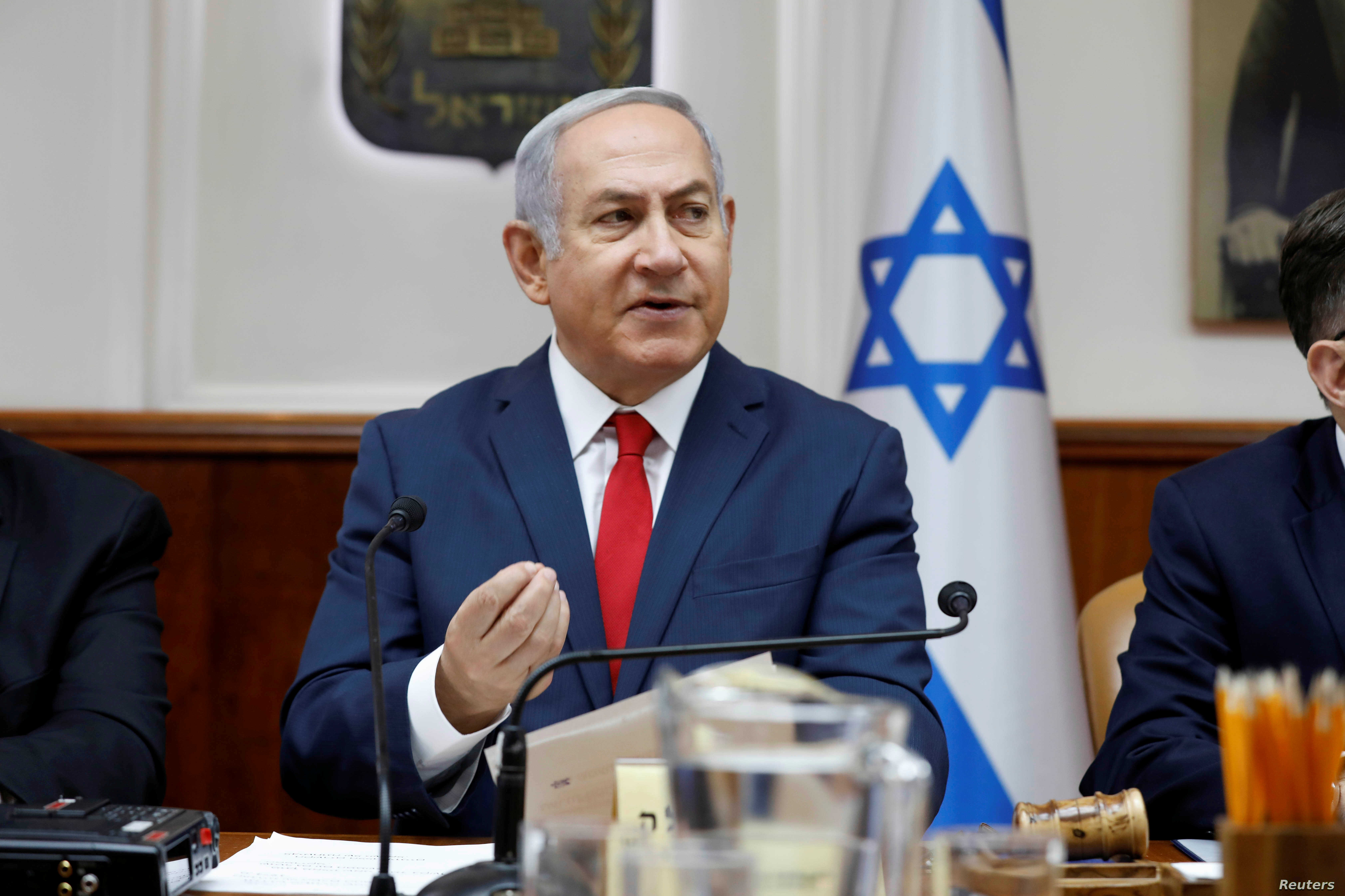 Israeli Prime Minister Benjamin Netanyahu attends the weekly cabinet meeting at his office in Jerusalem, July 8, 2018.