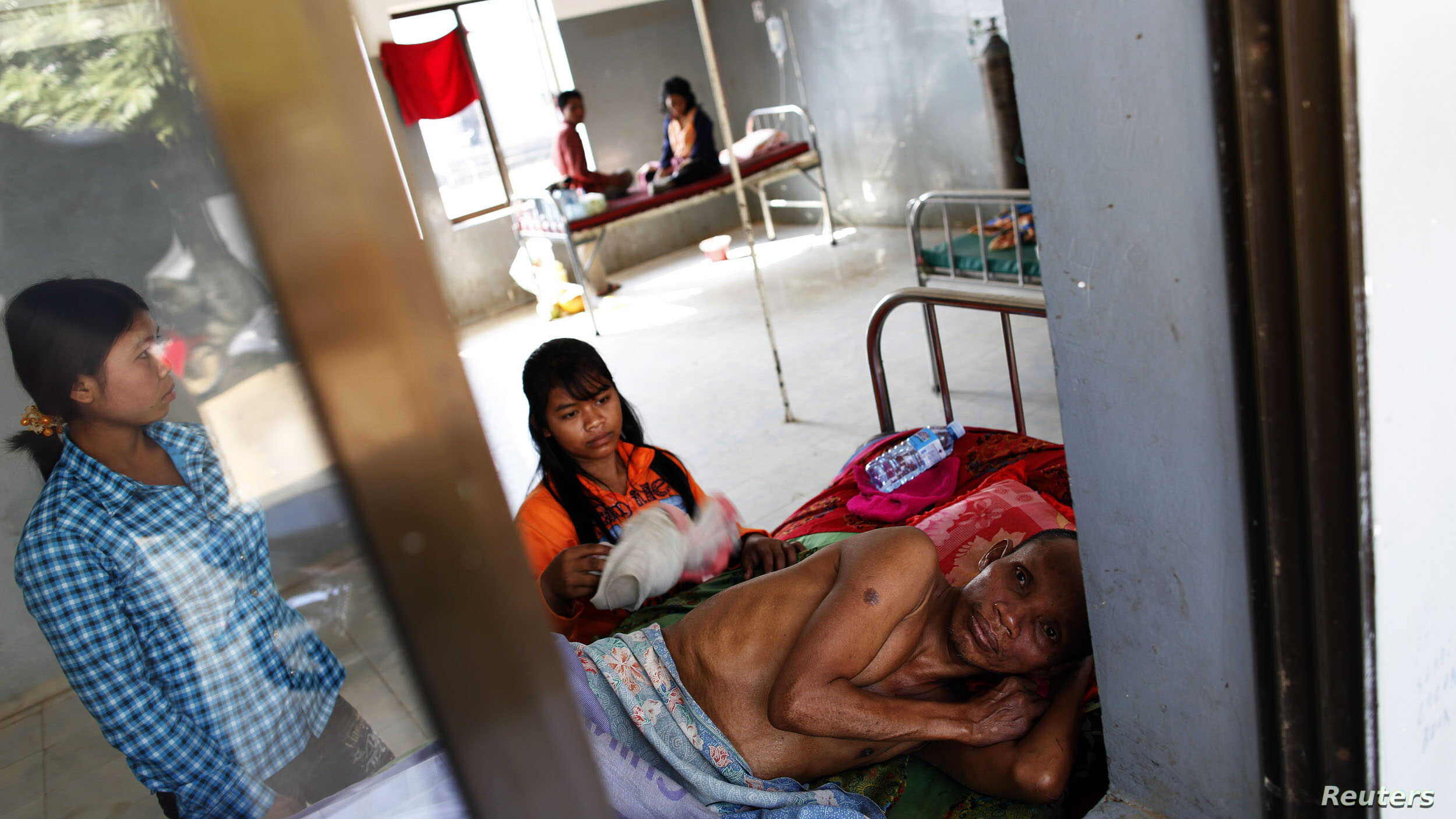 A malaria patient is comforted in the only hospital in Pailin, western Cambodia. (File)