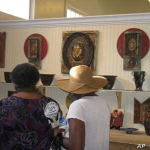 Visitors check out Lori Gordon's work at Gallery 220 in Bay St. Louis, Mississippi.