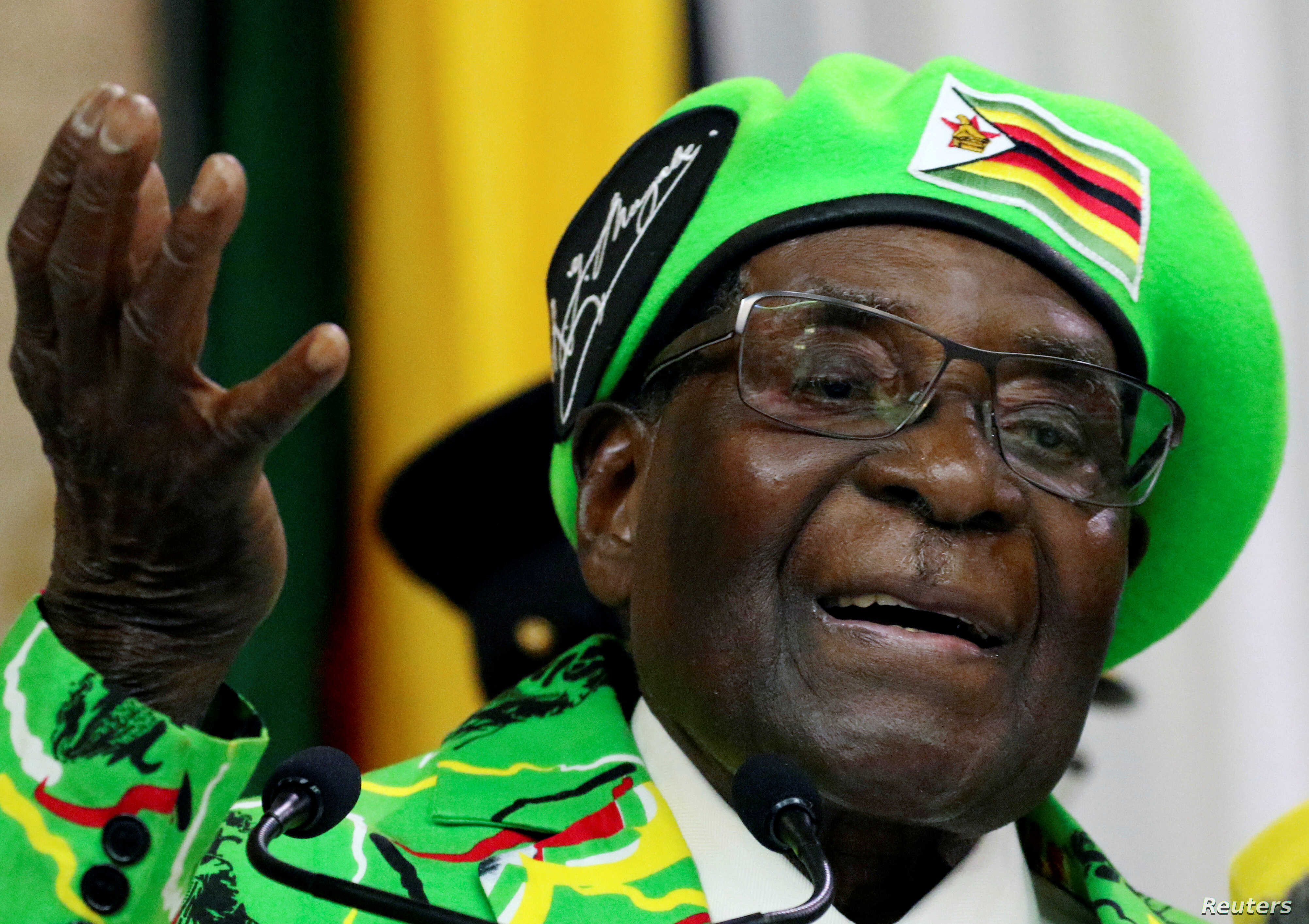 FILE - Former Zimbabwean President Robert Mugabe addresses a meeting of his party's youth league in Harare, Zimbabwe, Oct. 7, 2017.