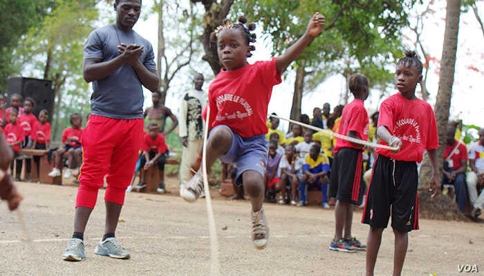 Mama Camara trains in double Dutch jump rope. At age 9, her right arm was amputated, but she resumed jumping soon afterward in Conakry, Guinea. (Courtesy photo / International Medalist Association)