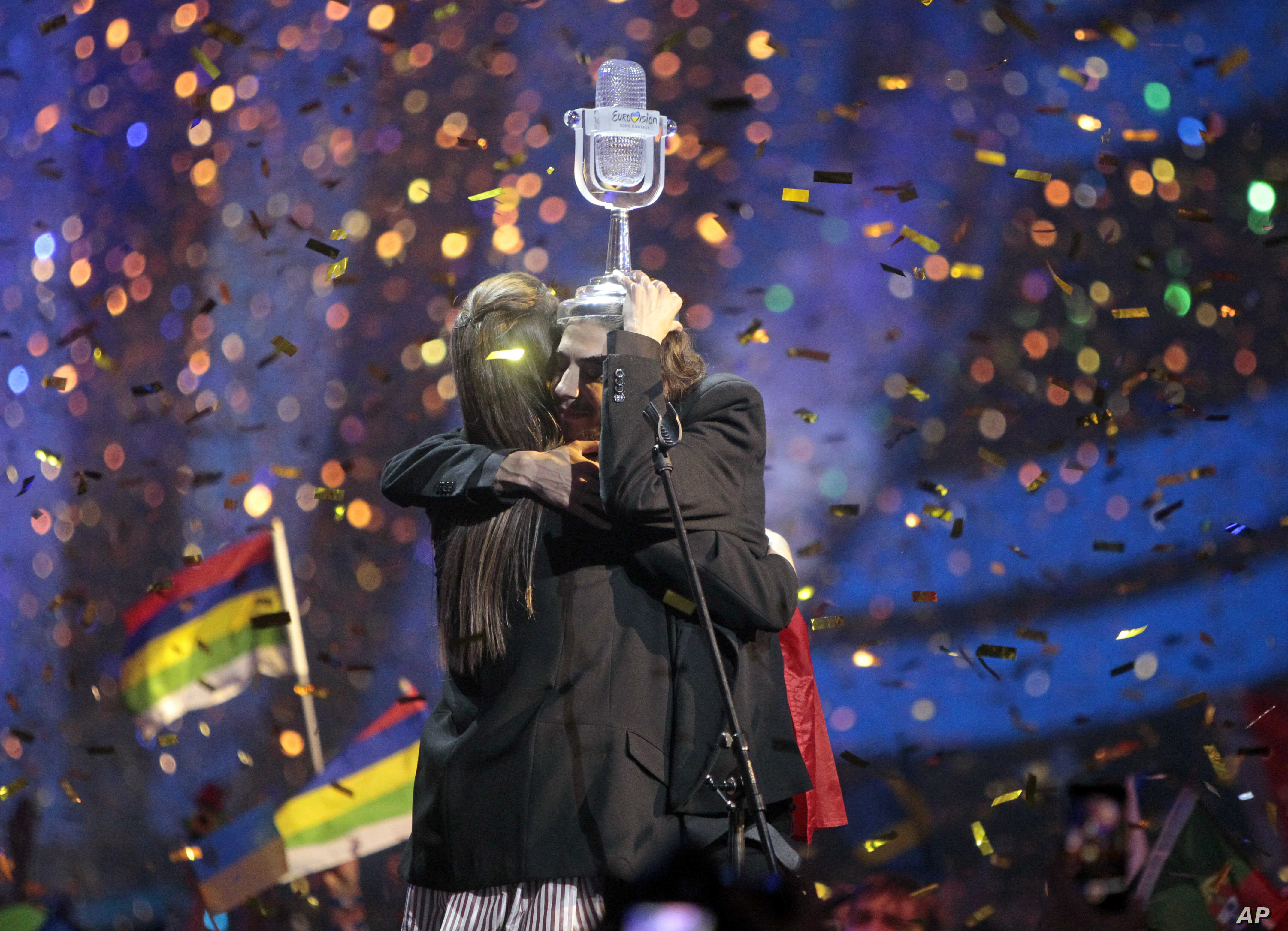"""Salvador Sobral from Portugal, right, embraces his sister Luisa after performing the song """"Amar pelos dois"""" following his win in the Final of the Eurovision Song Contest, in Kyiv, Ukraine, May 13, 2017."""
