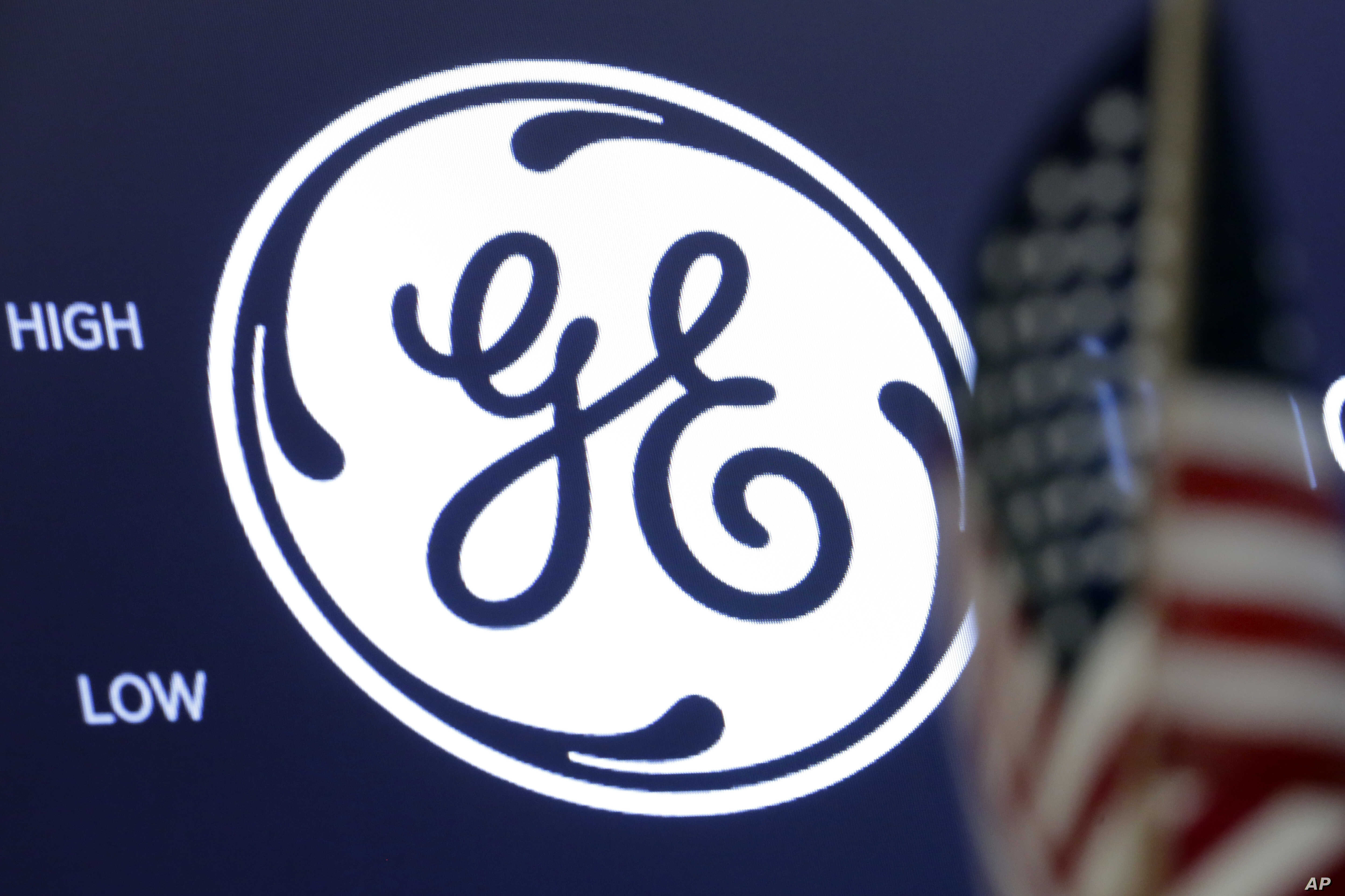 The General Electric logo appears above a trading post on the floor of the New York Stock Exchange, June 26, 2018.