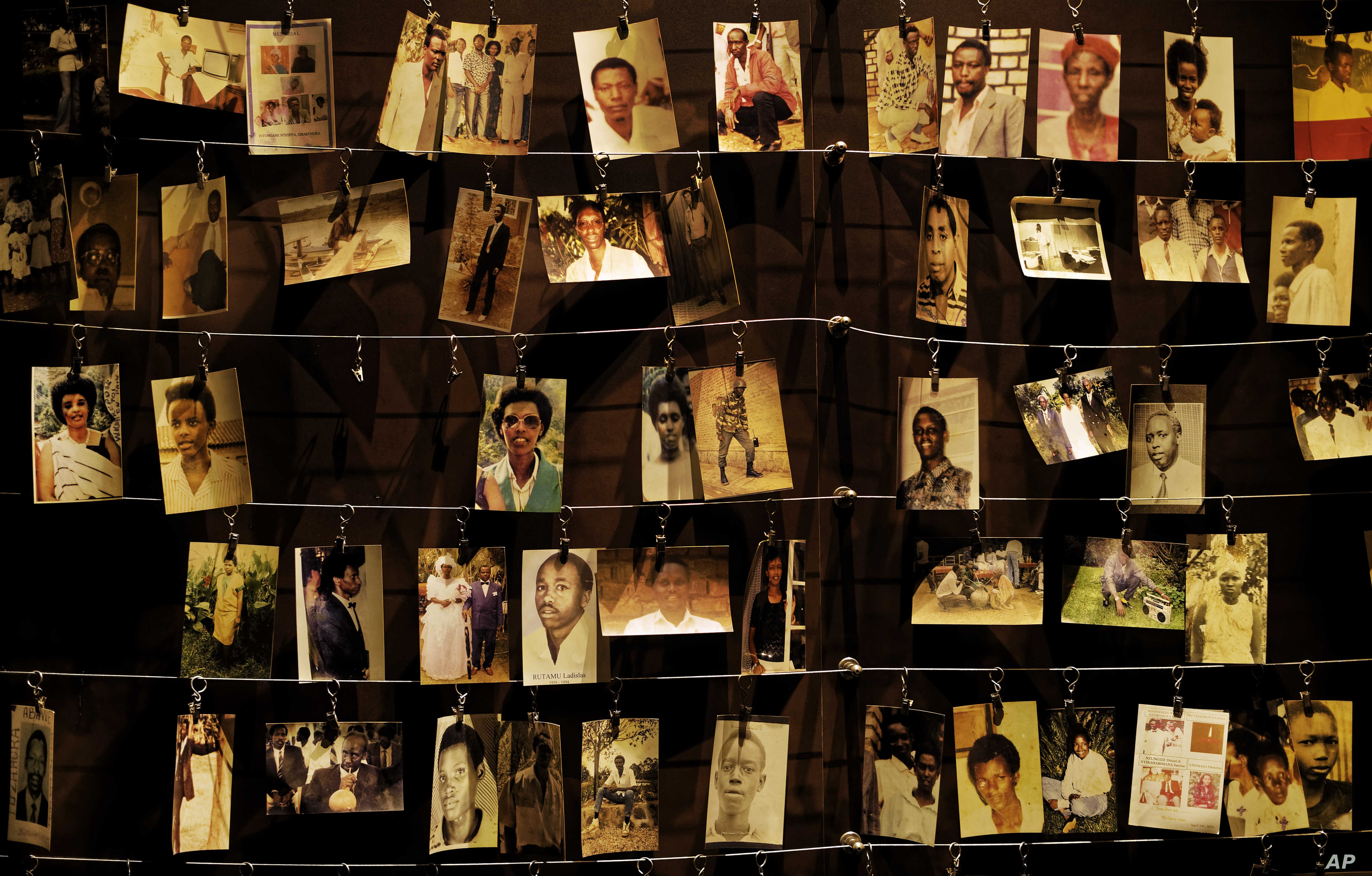 Family photographs of some of those who died hang on display in an exhibition at the Kigali Genocide Memorial centre in the capital Kigali, Rwanda, April 5, 2019.