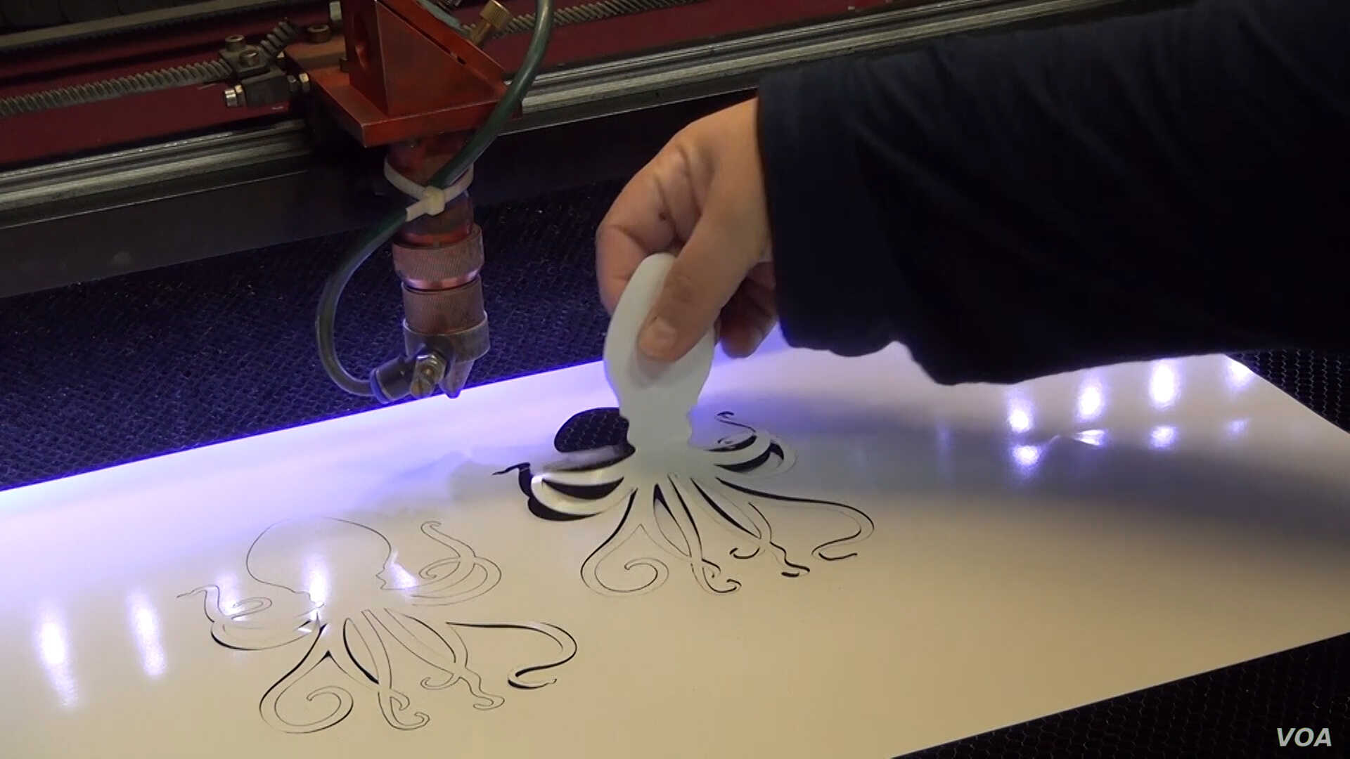 The massive laser cutter at Ace Monster Toys can handle the most delicate tasks.
