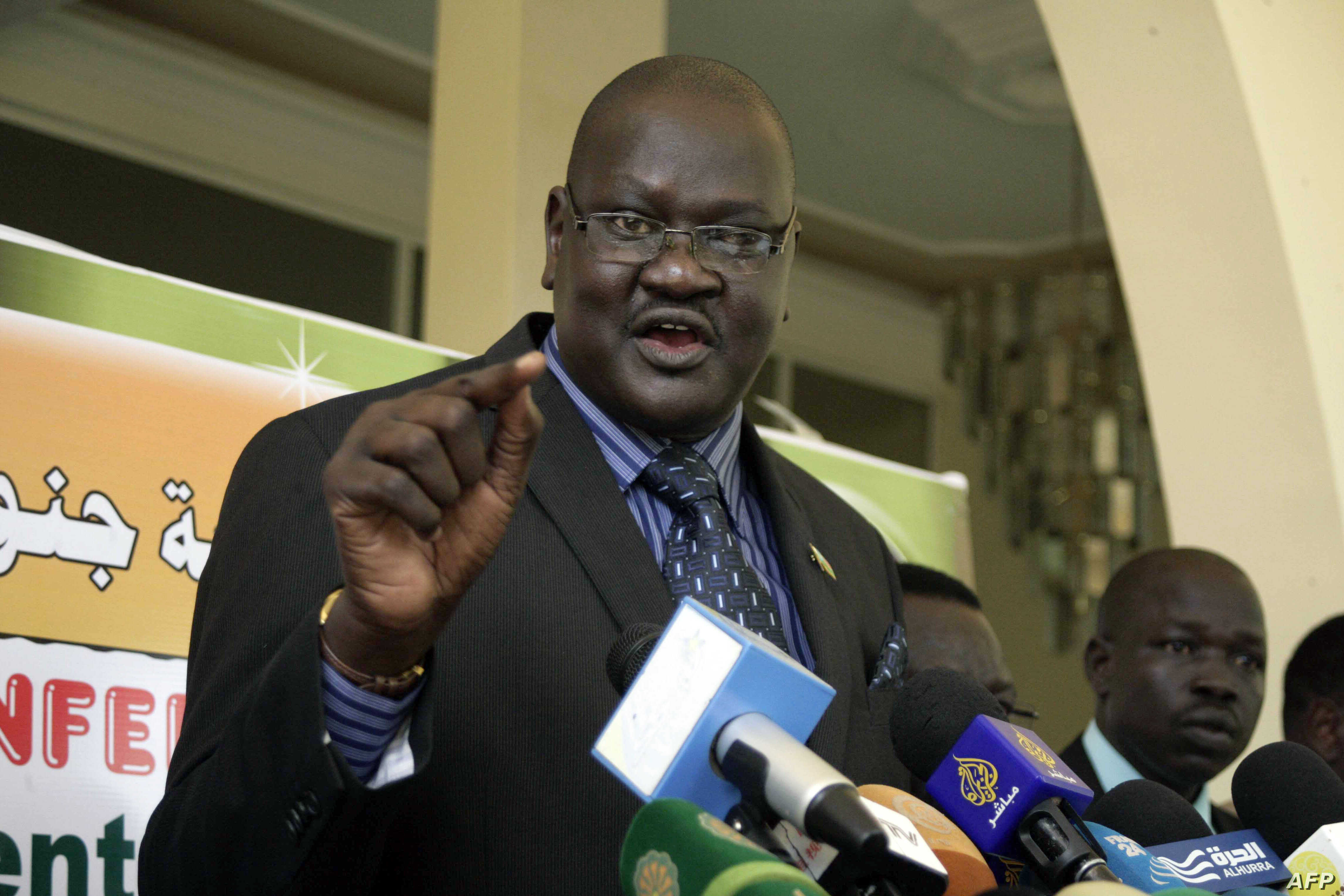 FILE - Ateny Wek Ateny, press secretary to South Sudan President Salva Kiir, speaks during a press conference in the Sudanese capital, Khartoum, March 2, 2014.