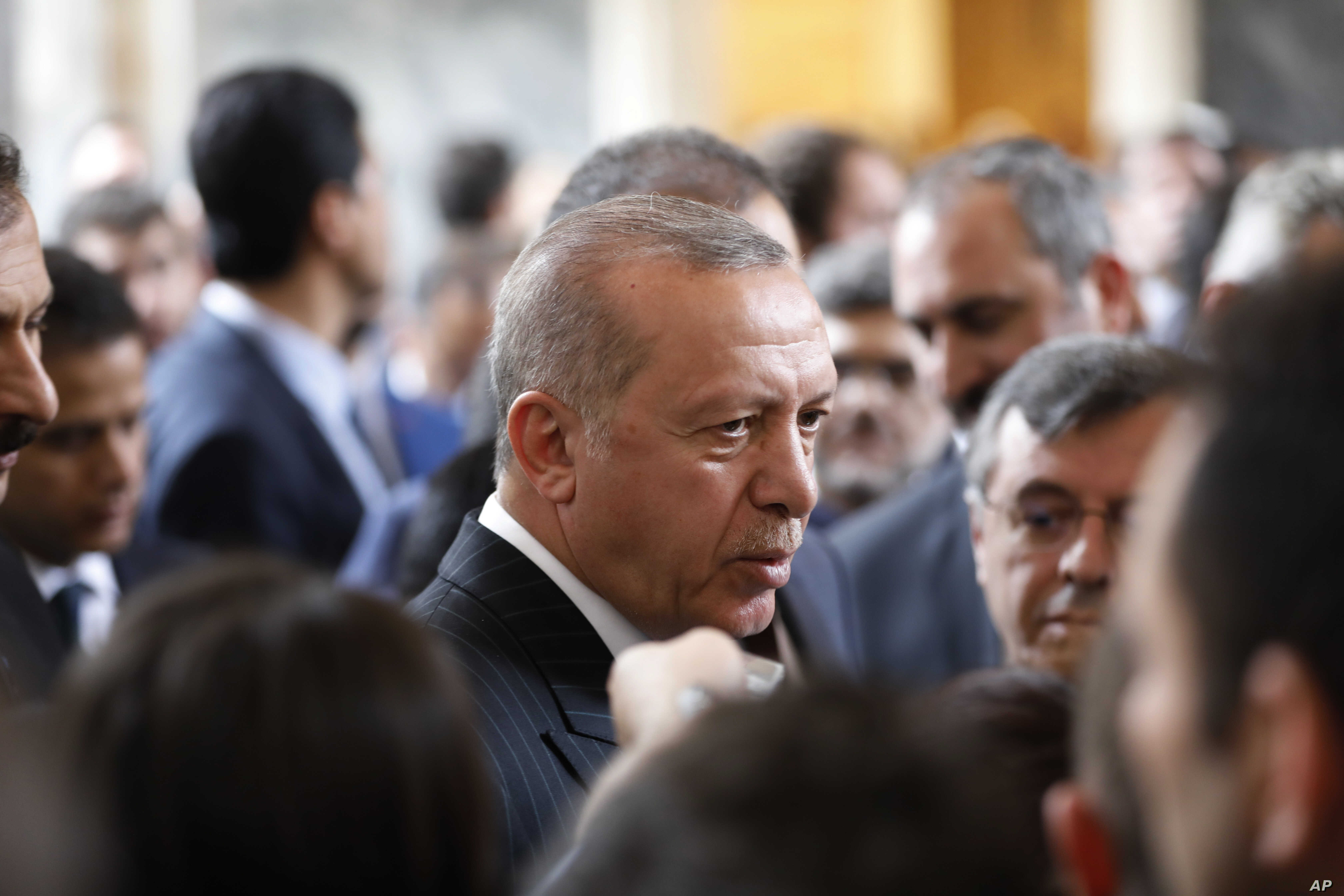 Turkey's President Recep Tayyip Erdogan, talks to MPs of his ruling Justice and Development Party (AKP) after delivering a speech at the parliament in Ankara, Turkey, Tuesday, Nov. 20, 2018.