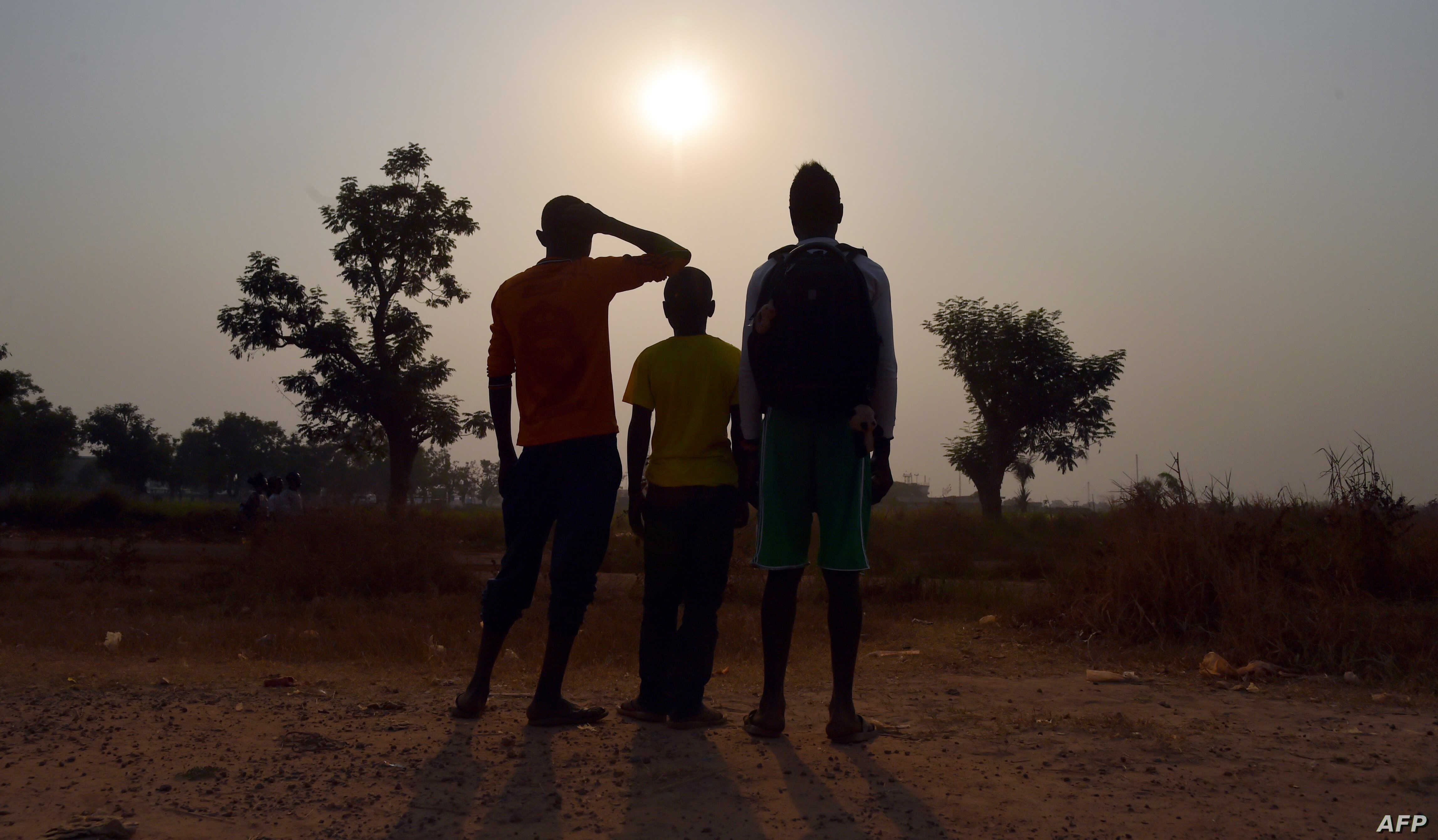 FILE - Three children living in the camp for Internally displaced people (IDP) of Mpoko, and claiming to be victims or witnesses of sexual abuse on minors by peacekeeper soldiers of the French Sangaris operation, posing in Bangui, Feb. 11, 2016.