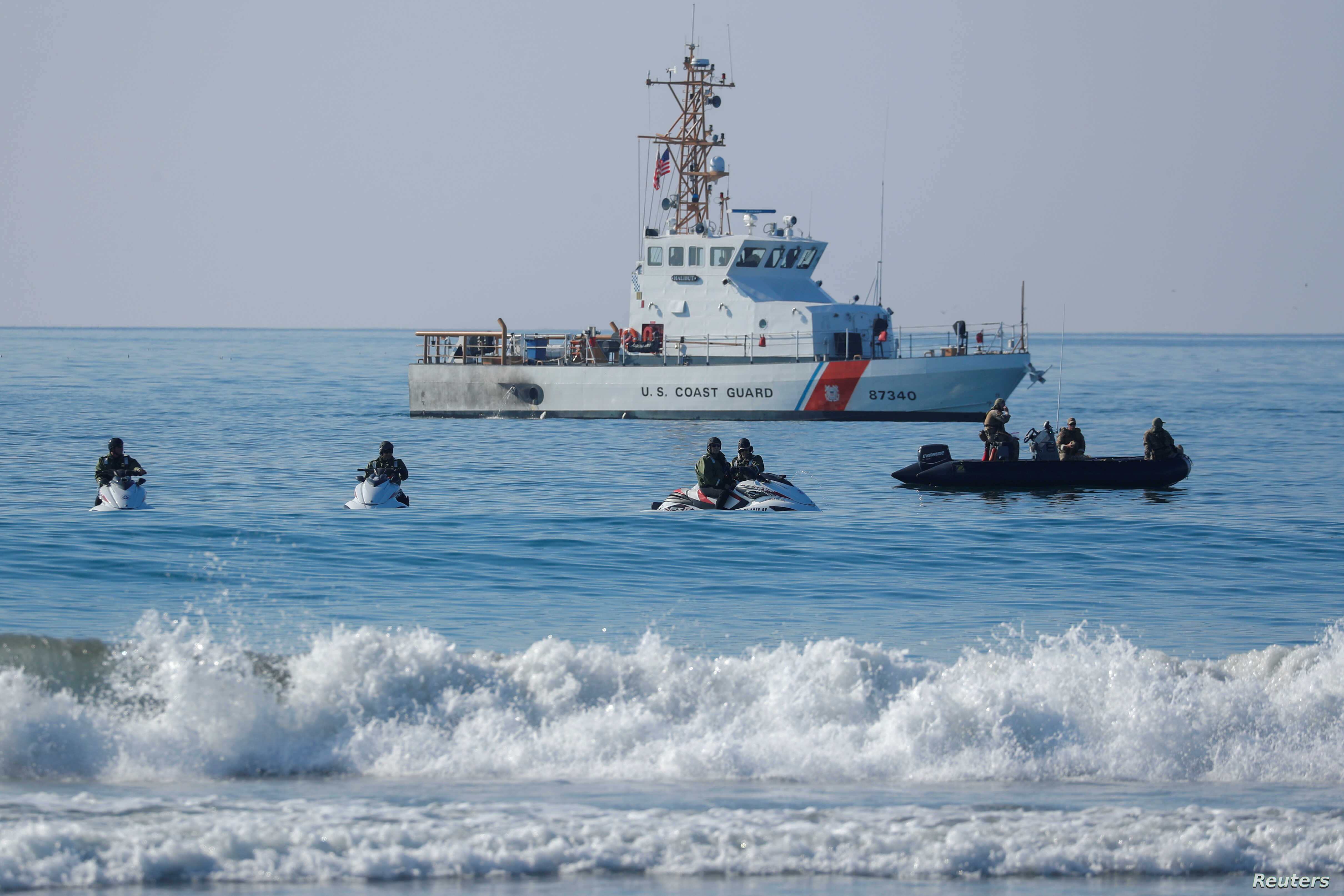 U.S. Border agents and the Coast Guard patrol the Pacific Ocean where the U.S. Mexico border wall enters the water at Border Field State Park in San Diego, California, Nov. 20, 2018.