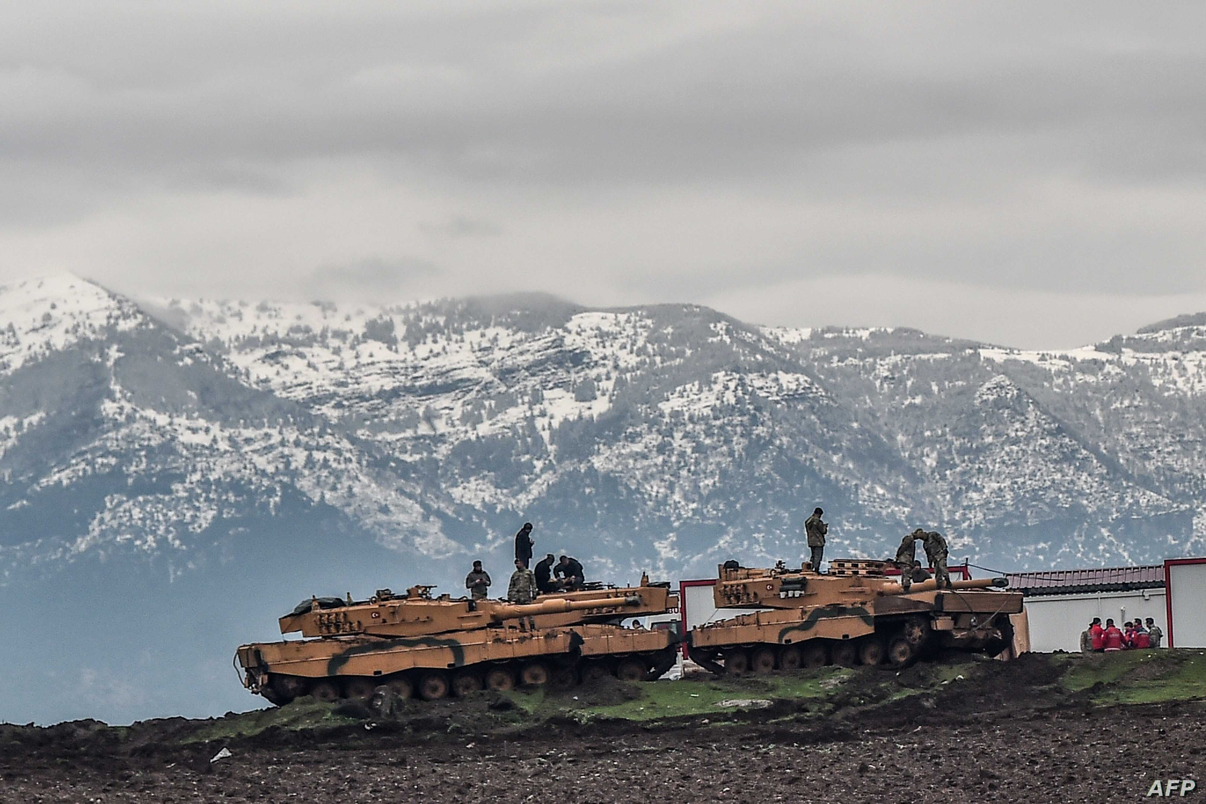 "Turkish tanks are parked near the Syrian border at Hassa, in Hatay province on January 24, 2018, as part of the operation ""Olive Branch"", launched a few days ago."