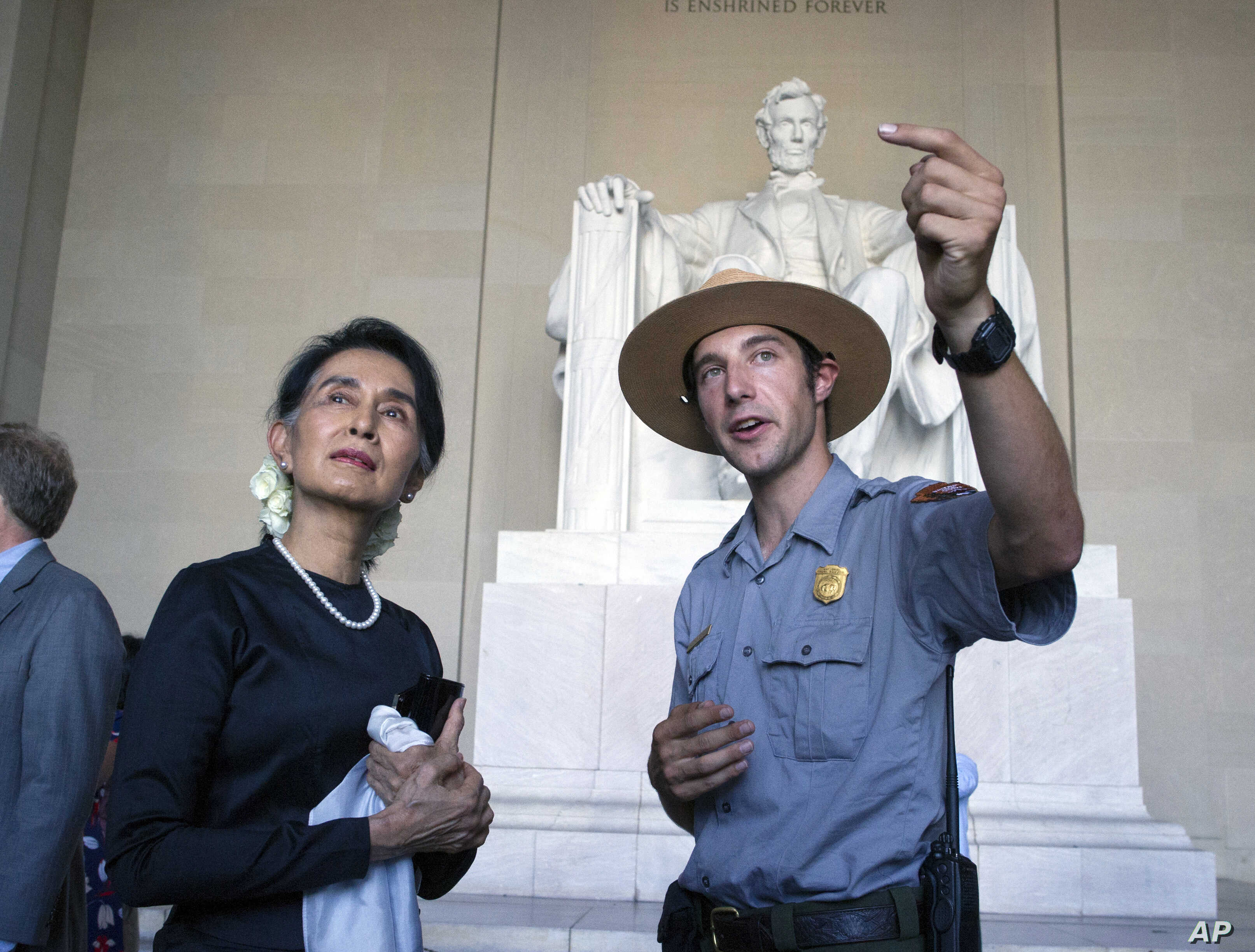 Myanmar leader Aung San Suu Kyi takes a tour of the Lincoln Memorial with National Park Service ranger Heath Mitchell in Washington, Sept. 14, 2016.