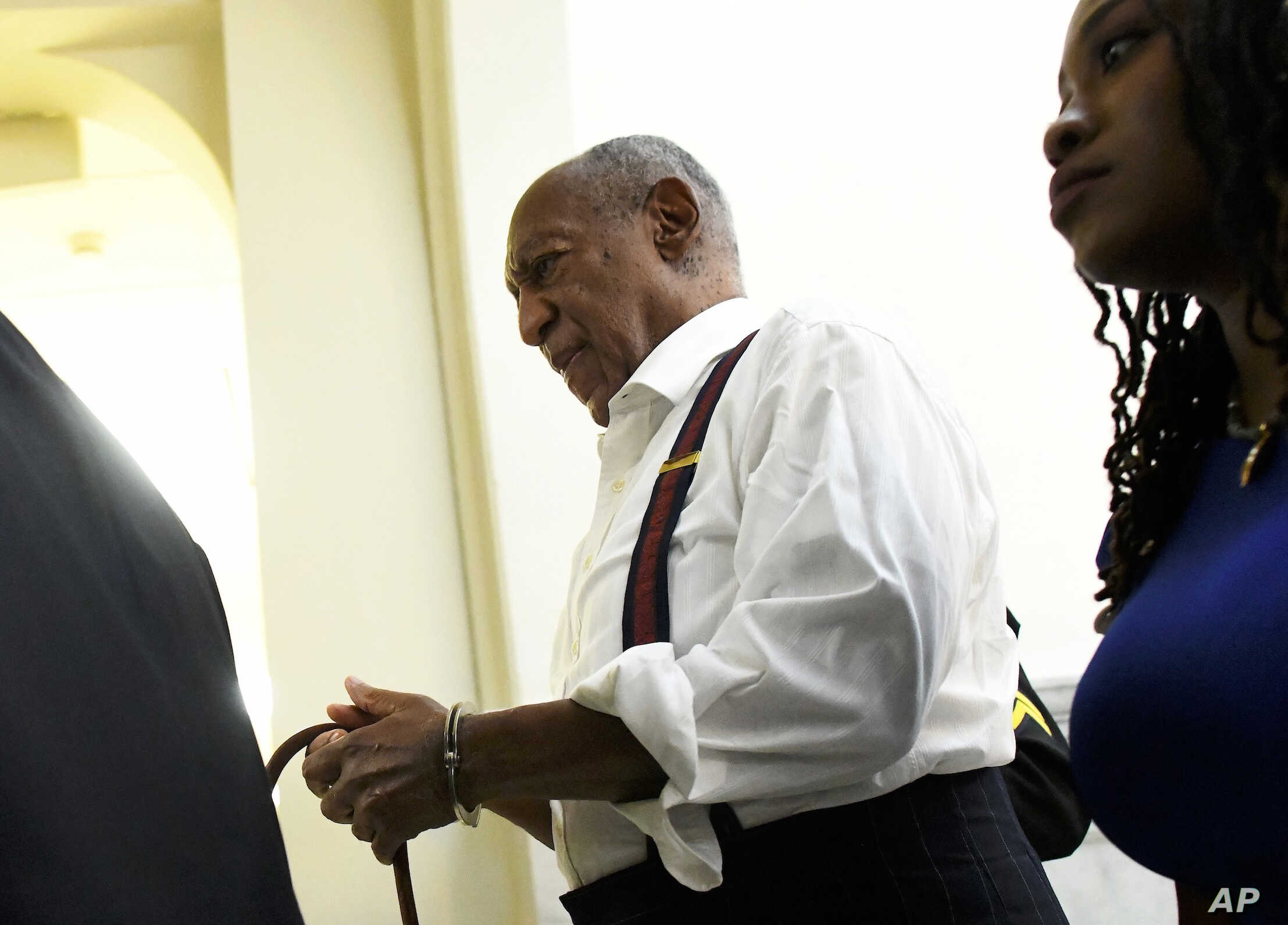 Bill Cosby is taken away in handcuffs after he was sentenced to three-to 10-years for felony sexual assault on Tuesday, Sept. 25, 2018, in Norristown, Pa.