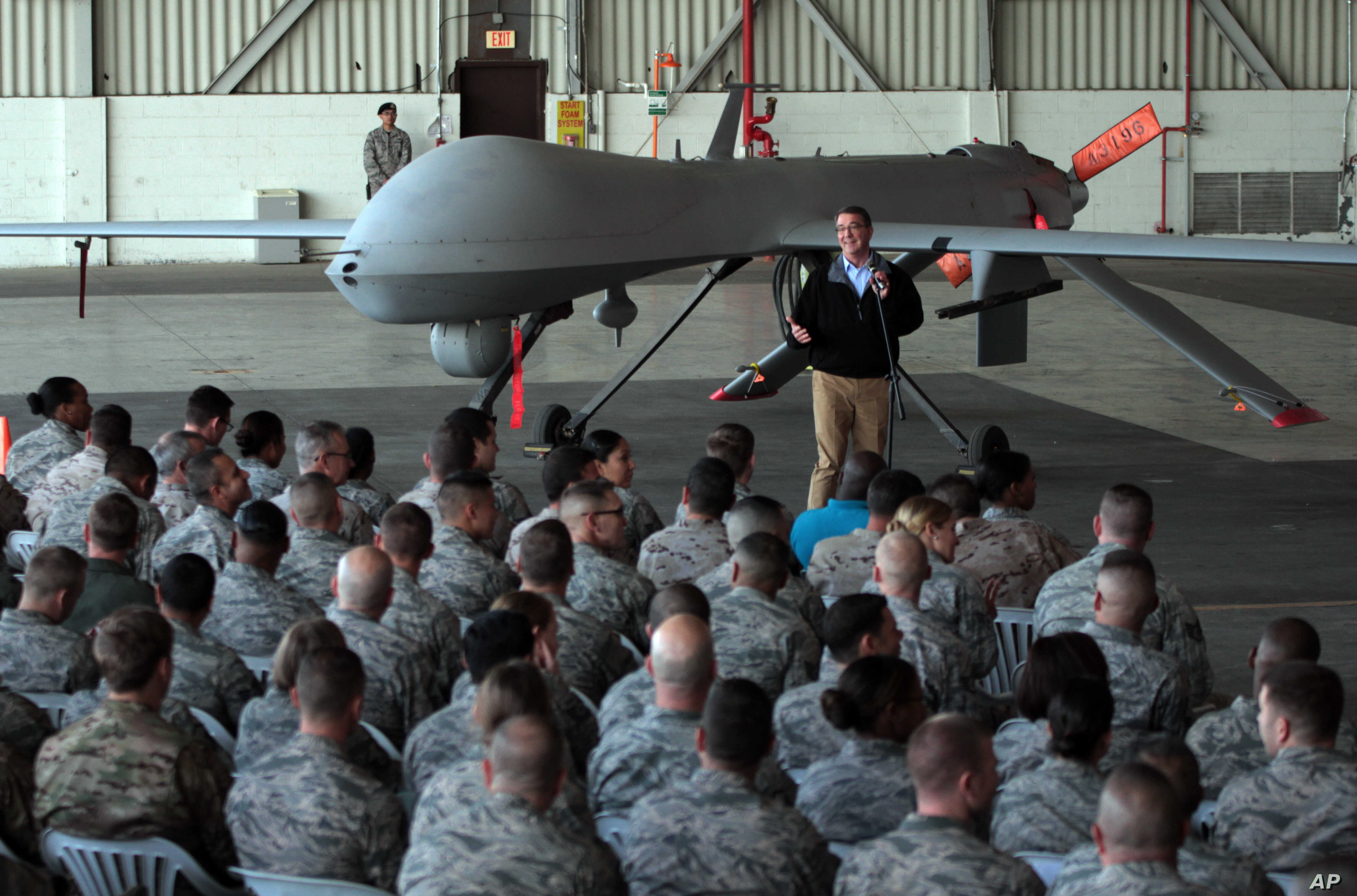 U. S. Defense Secretary Ash Carter addresses the U.S. troops as he stands in front of a drone at the Incirlik Air Base near Adana, Turkey, Dec. 15, 2015.