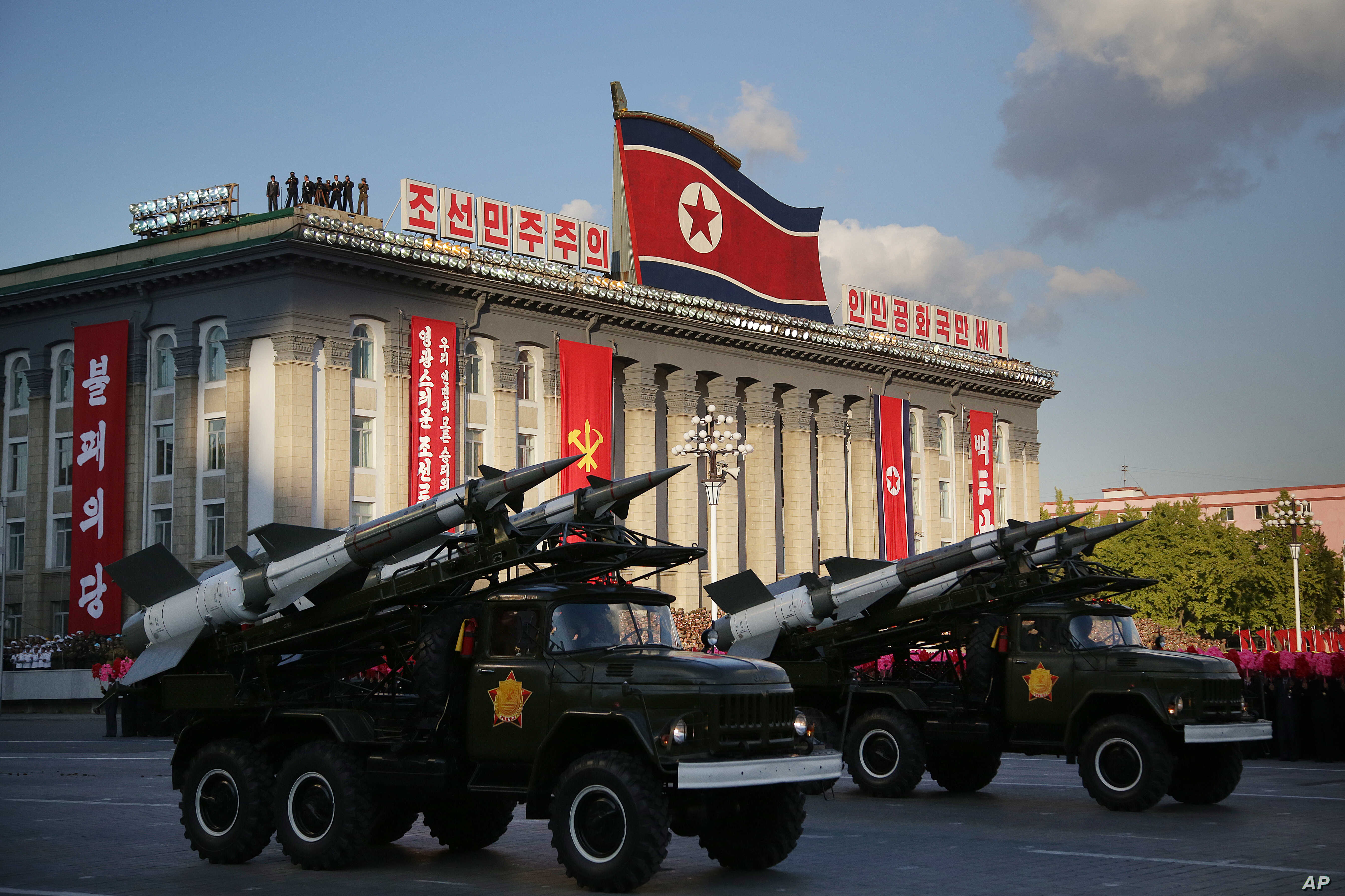 North Korean soldiers parade through Kim Il Sung Square with their missiles and rockets during a mass military parade, Oct. 10, 2015, in Pyongyang, North Korea.