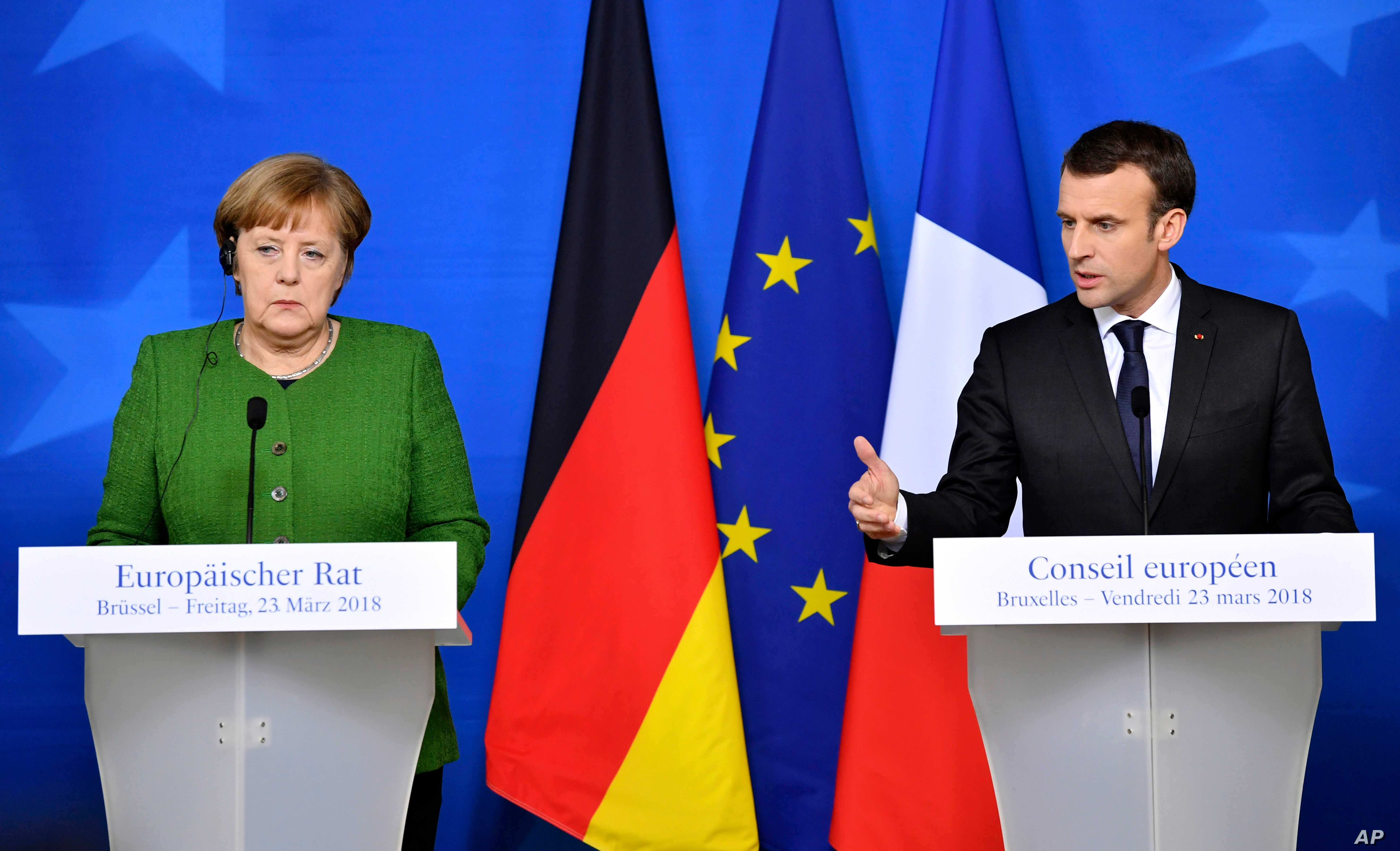 FILE - In this March 23, 2018, file photo, French President Emmanuel Macron, right, and German Chancellor Angela Merkel speak at a news conference in Brussels.