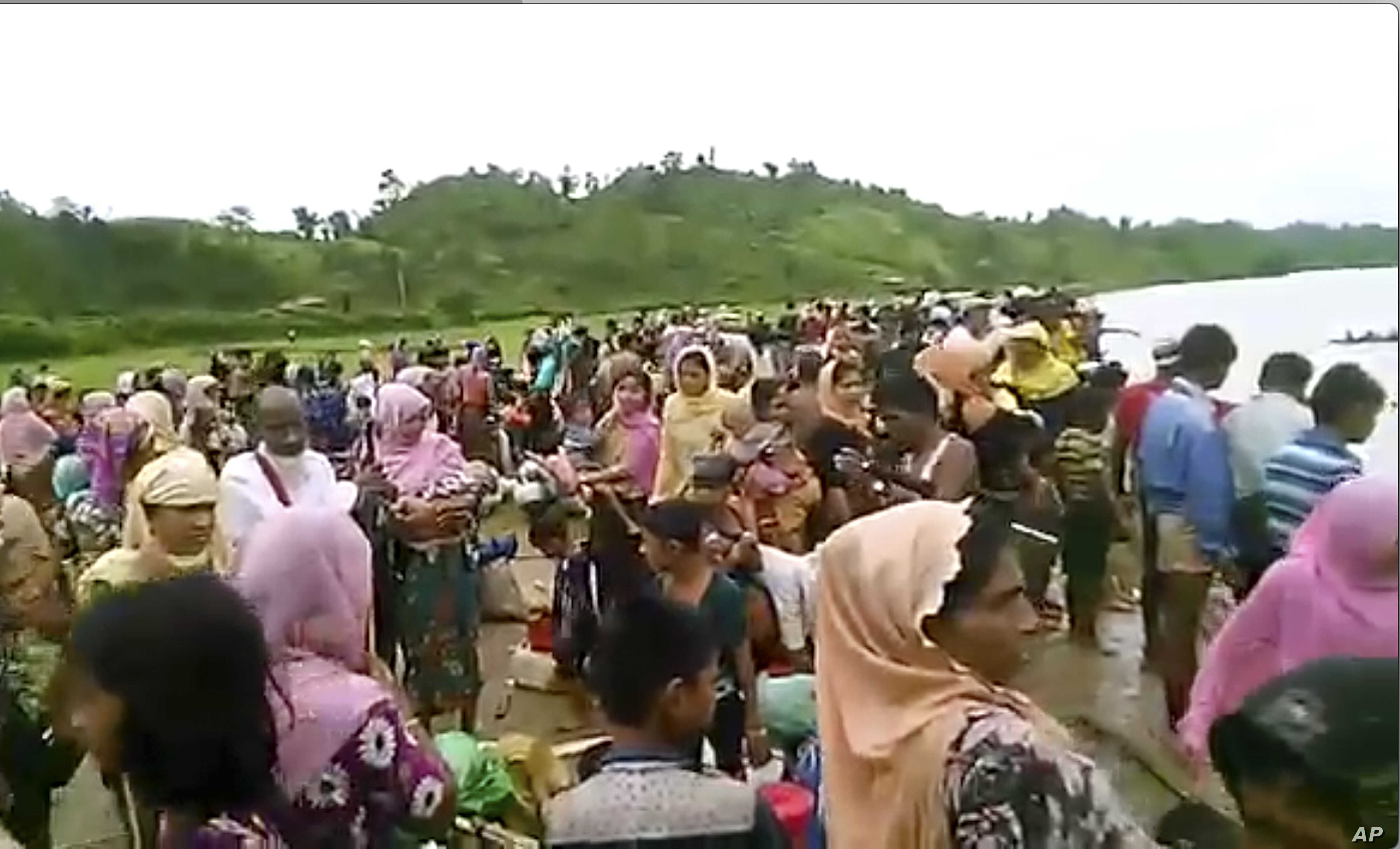 An Oct. 5, 2017 image taken from a video released by Arakan Rohingya National Organization shows villagers preparing to cross a river towards  the Maungdaw township in the Rakhine state that borders Bangladesh.