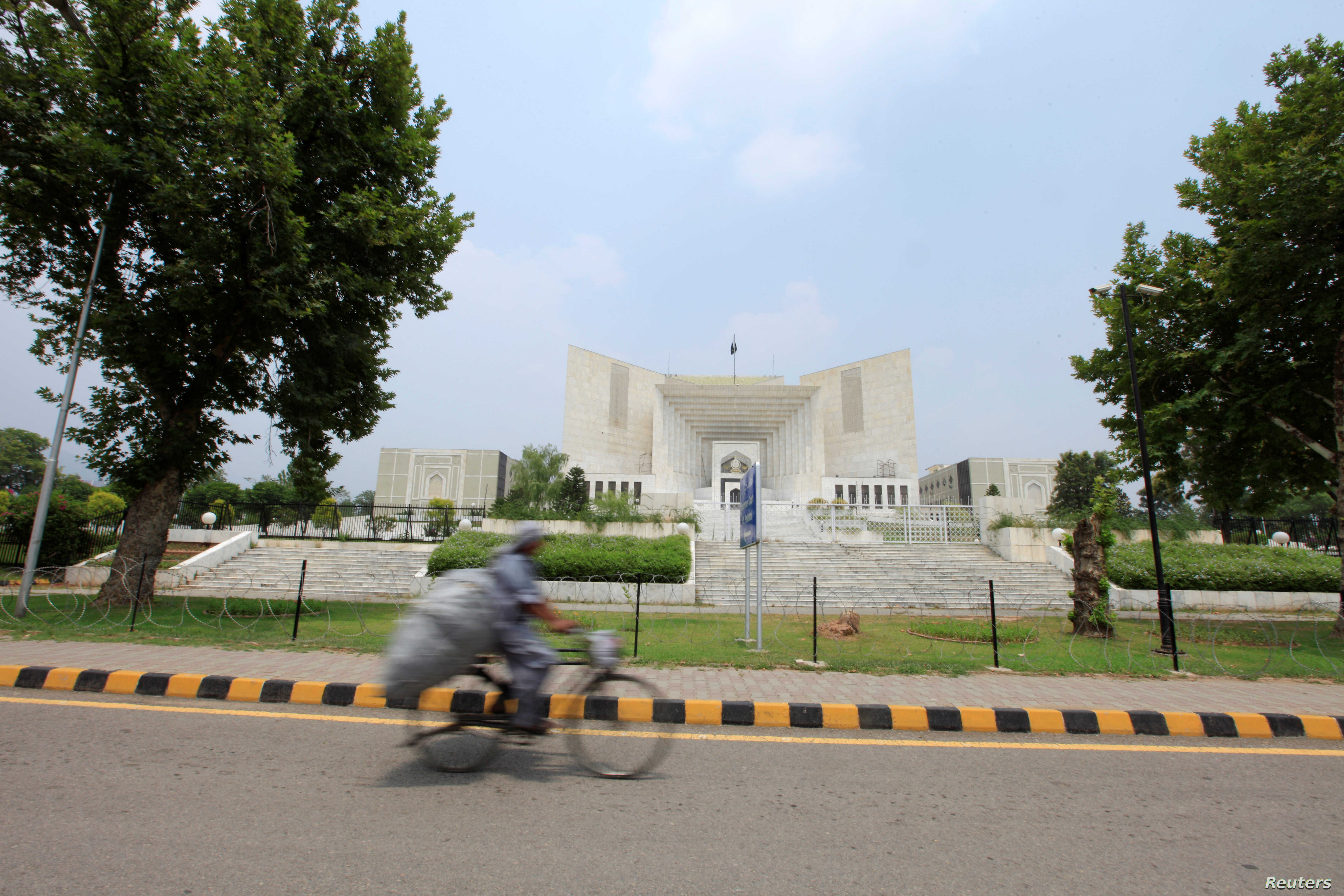 On Islamabad's Bike Lanes, Residents Pedal Towards A Greener