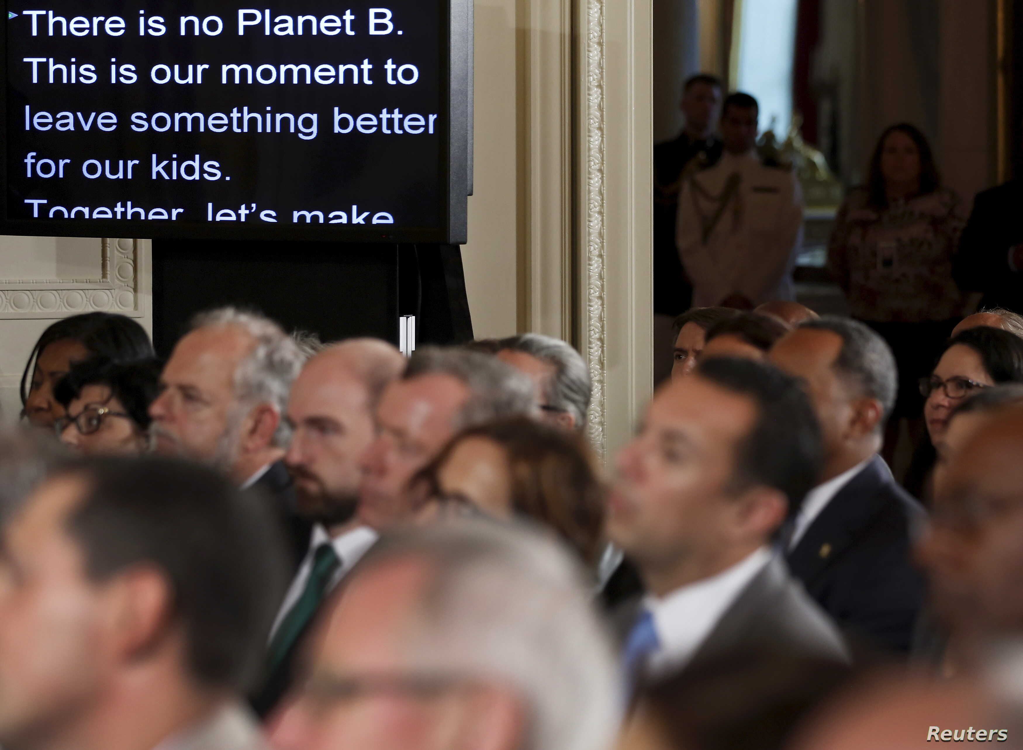 FILE - US President Barack Obama's remarks are shown on large monitors in the East Room as he addresses climate change and the Clean Power Plan at the White House in Washington, Aug. 3, 2015.