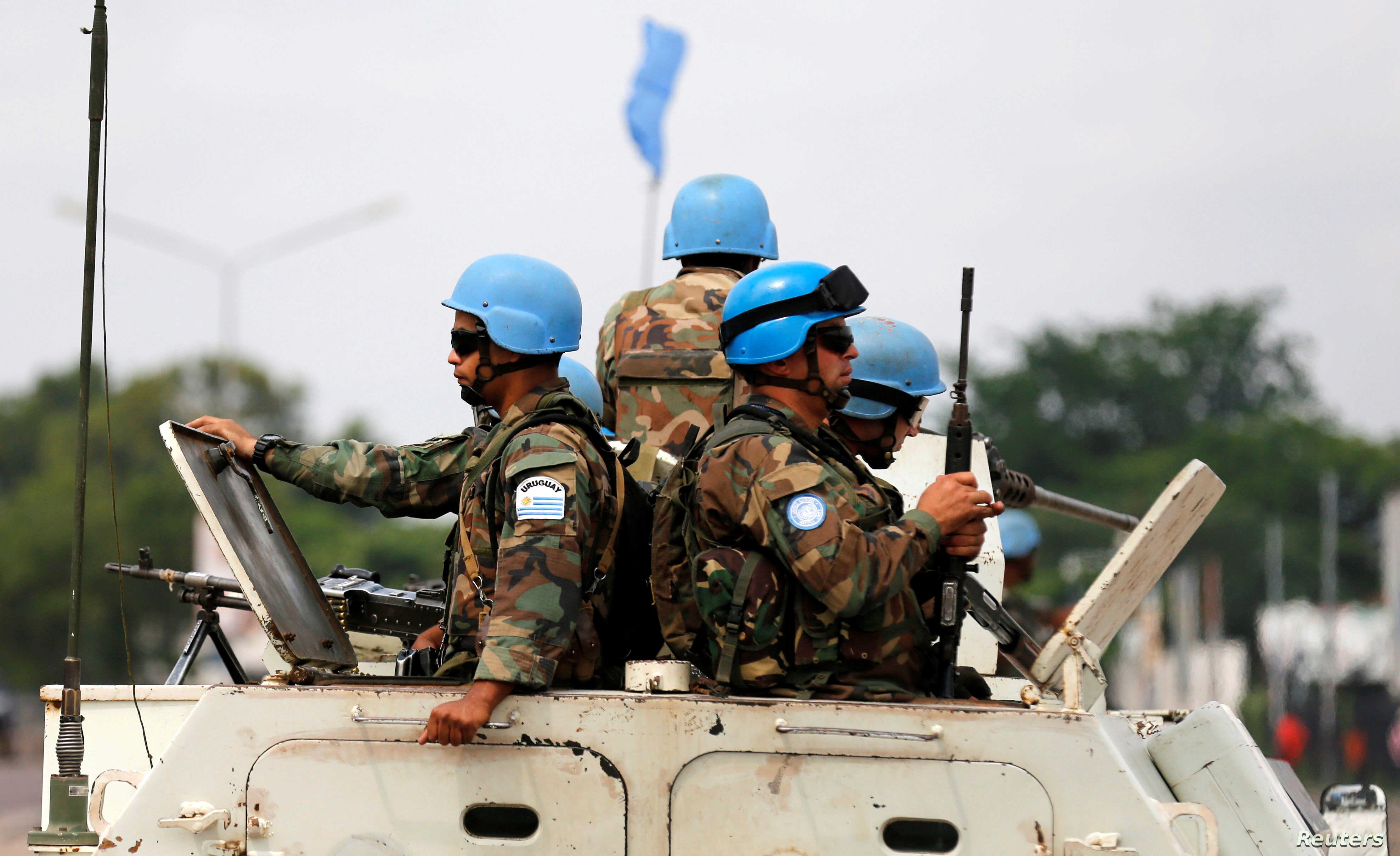 FILE - Peacekeepers serving in the United Nations Organization Stabilization Mission in the Democratic Republic of the Congo (MONUSCO) patrol in their armoured personnel carrier during demonstrations against Congolese President Joseph Kabila in the s...