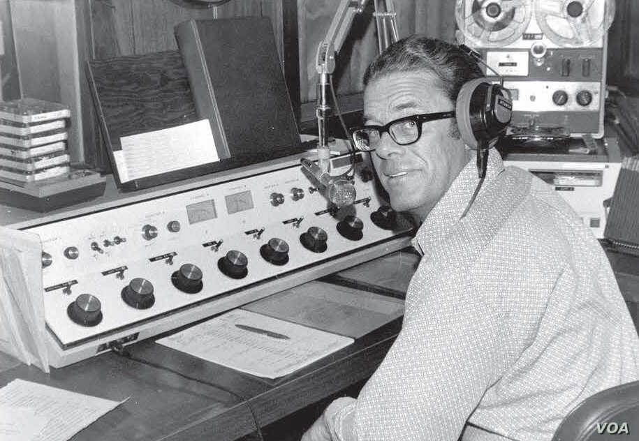 Father James Poole in the studio of KNOM radio, 1973.  Poole was accused of theabuse of girls in 1960s-70s at St. Mary's Mission Boarding School and other places. Courtesy: Jesuits West Archives at Gonzaga University