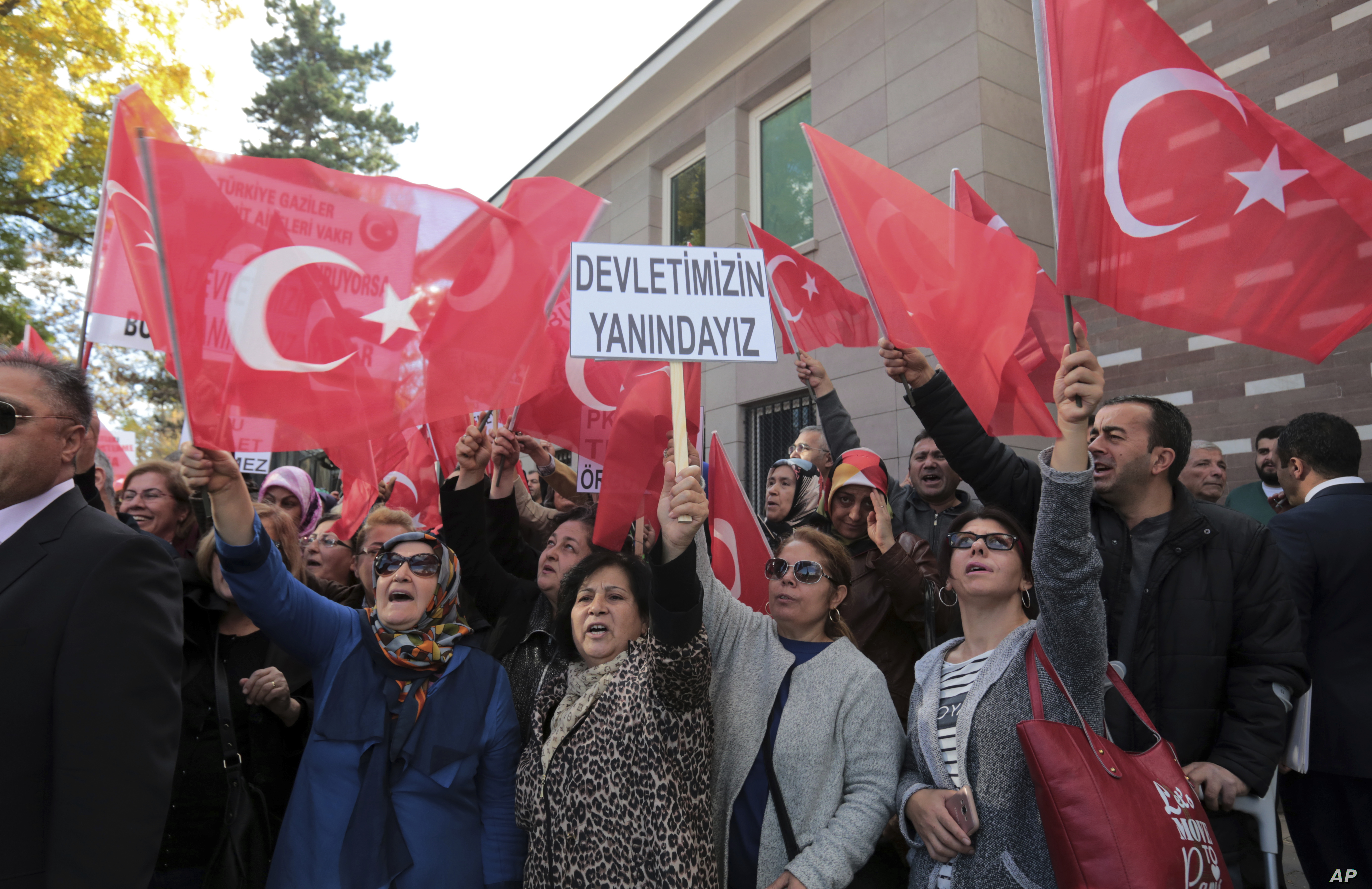 About 150 members of Turkey's ruling Justice and Development Party stage a protest outside the French embassy, accusing France of supporting terrorism, in Ankara, Turkey, Nov. 11, 2016.