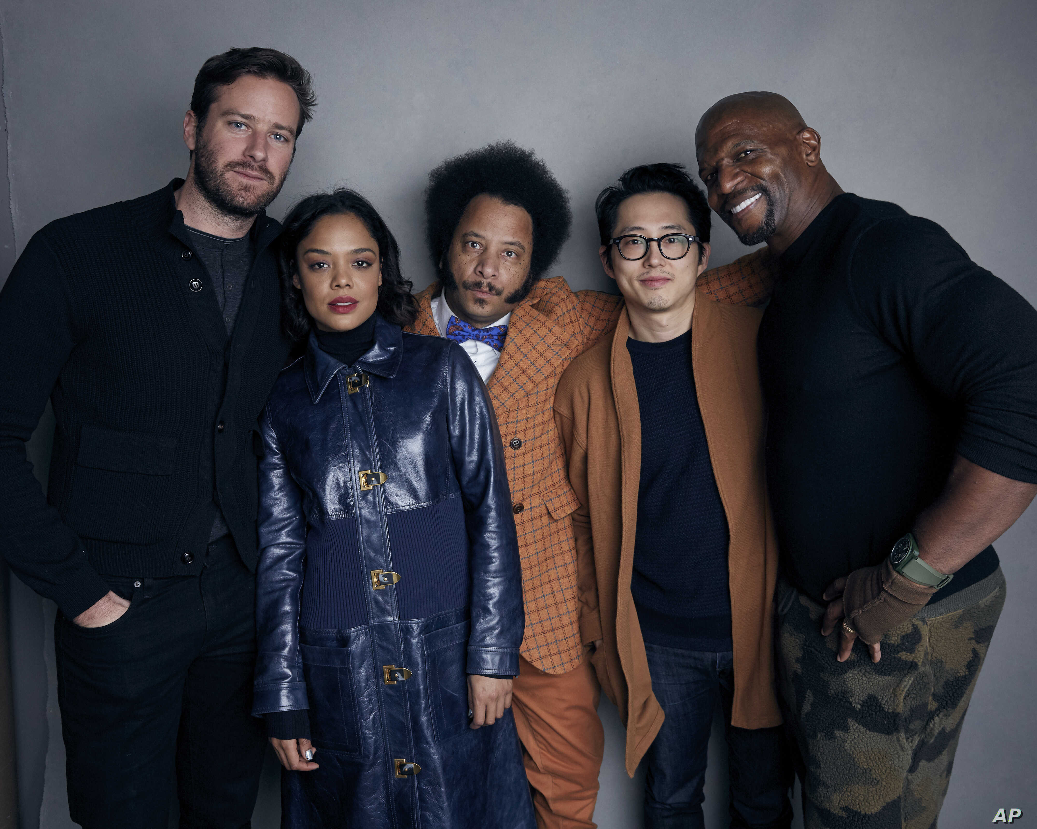 "FILE - Armie Hammer, from left, Tessa Thompson, director Boots Riley, Steven Yeun and Terry Crews pose for a portrait to promote the film, ""Sorry to Bother You,"" during the Sundance Film Festival in Park City, Utah, Jan. 21, 2018."