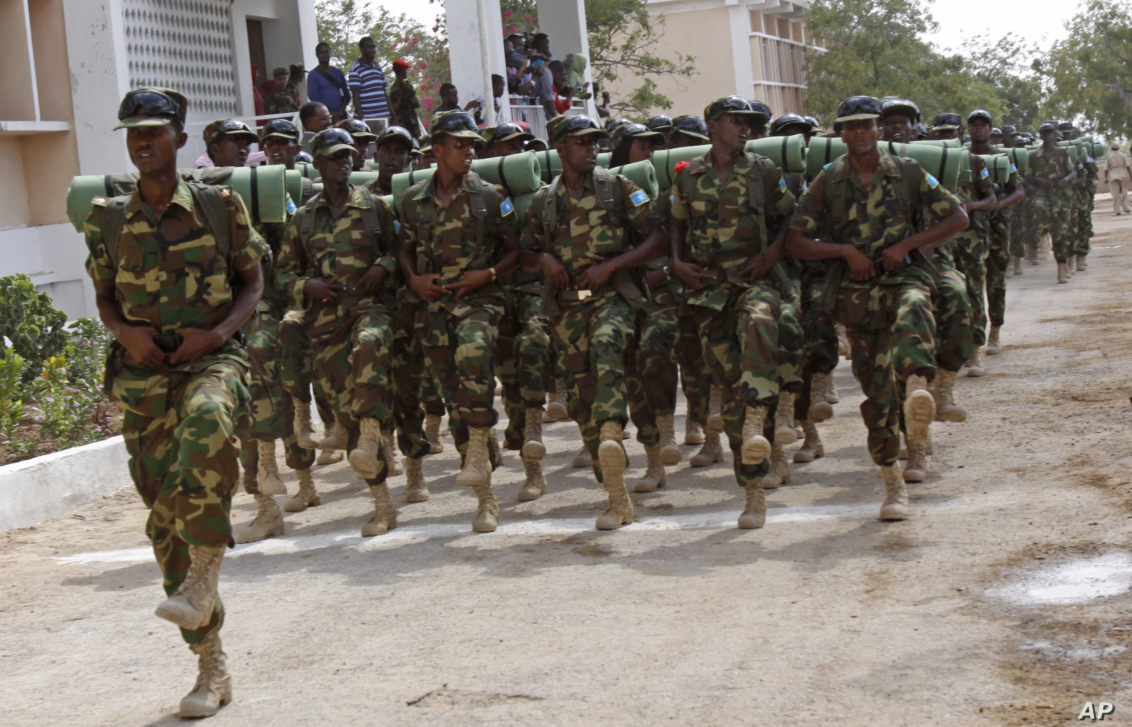 FILE - Somali soldiers march during the 54th anniversary of Somali National Army Day in Mogadishu, Somalia.