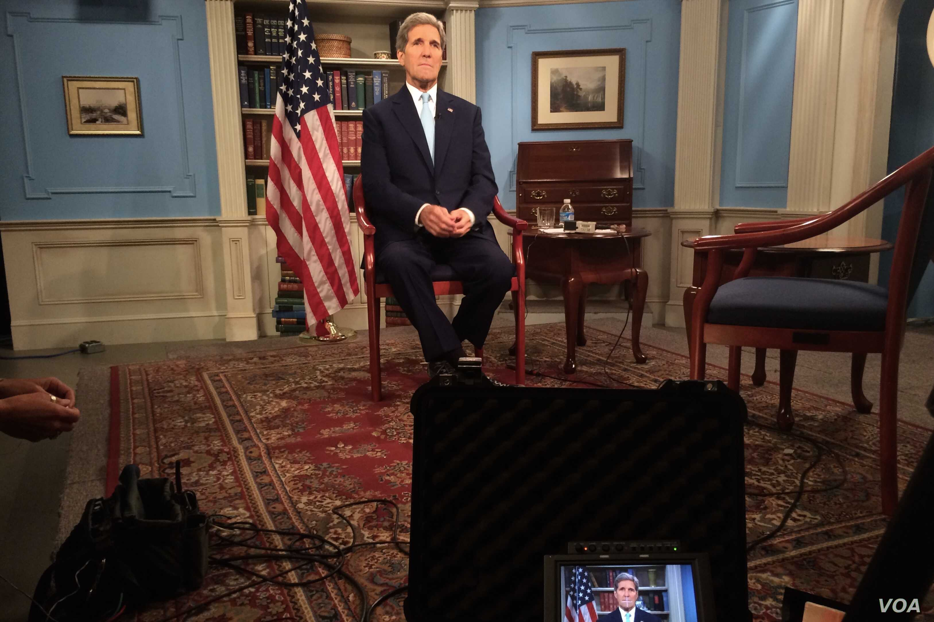 "U.S. Secretary of State John Kerry settles into his chair in a studio at the Department of State in Washington, D.C., before appearing on the MSNBC program ""Morning Joe"" on July 17, 2015, to discuss the E.U./P5+1/U.S.-Iranian nuclear deal."