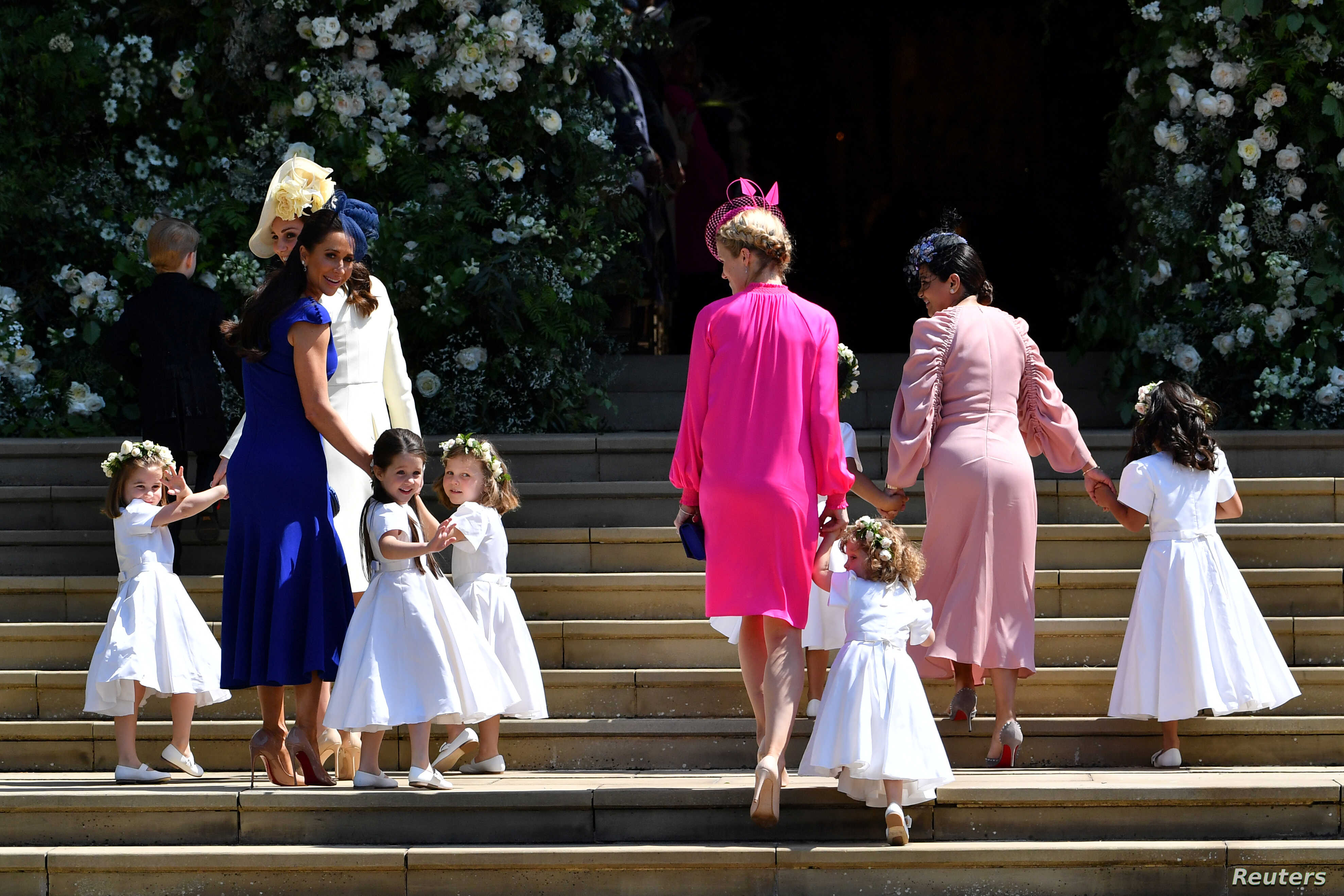 Britain's Catherine, Duchess of Cambridge and Meghan Markle's friend, Canadian fashion stylist Jessica Mulroney holds bridesmaids hands as they arrive for the wedding ceremony of Britain's Prince Harry, Duke of Sussex and U.S. actress Meghan Markle a...