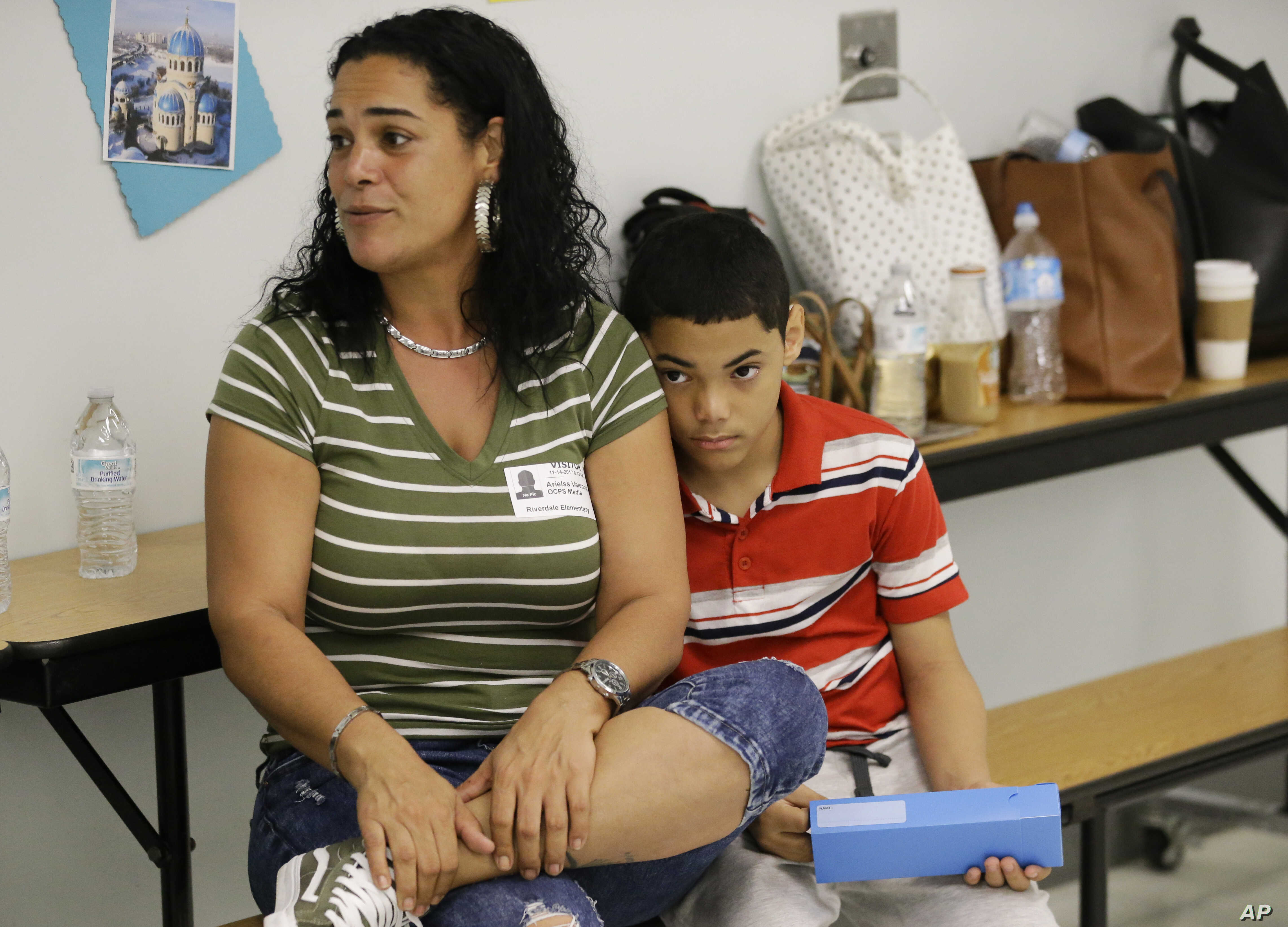Recent transplant from Puerto Rico, Arieliss Valencia sits next to her son Anthony, a fifth grader at Riverdale Elementary School in Orlando, Fla. Anthony left Puerto Rico with his family after Hurricane Maria destroyed his home.