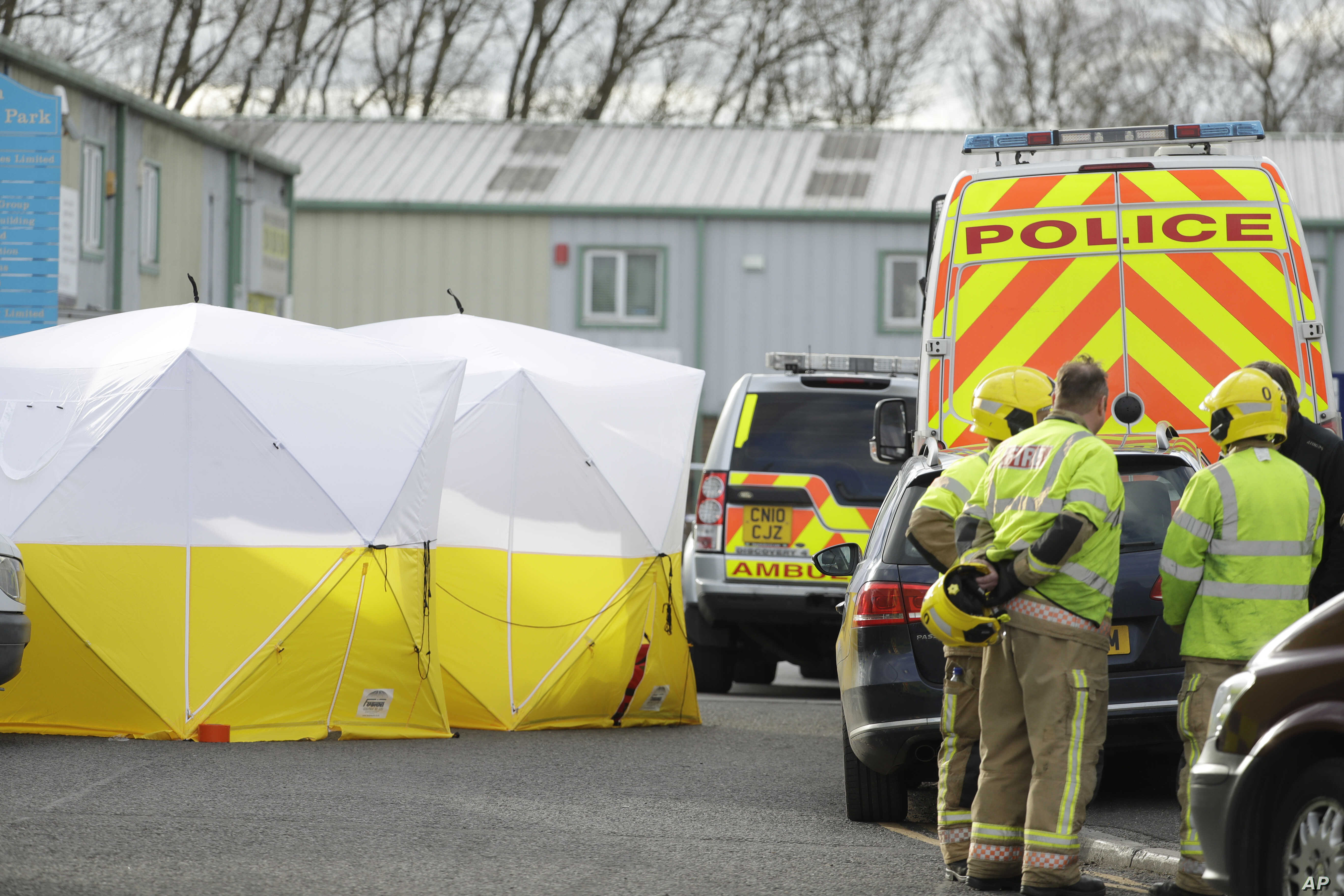 """Fire officers stand inside a cordon at the vehicle recovery business """"Ashley Wood Recovery"""" in Salisbury, England, March 13, 2018."""