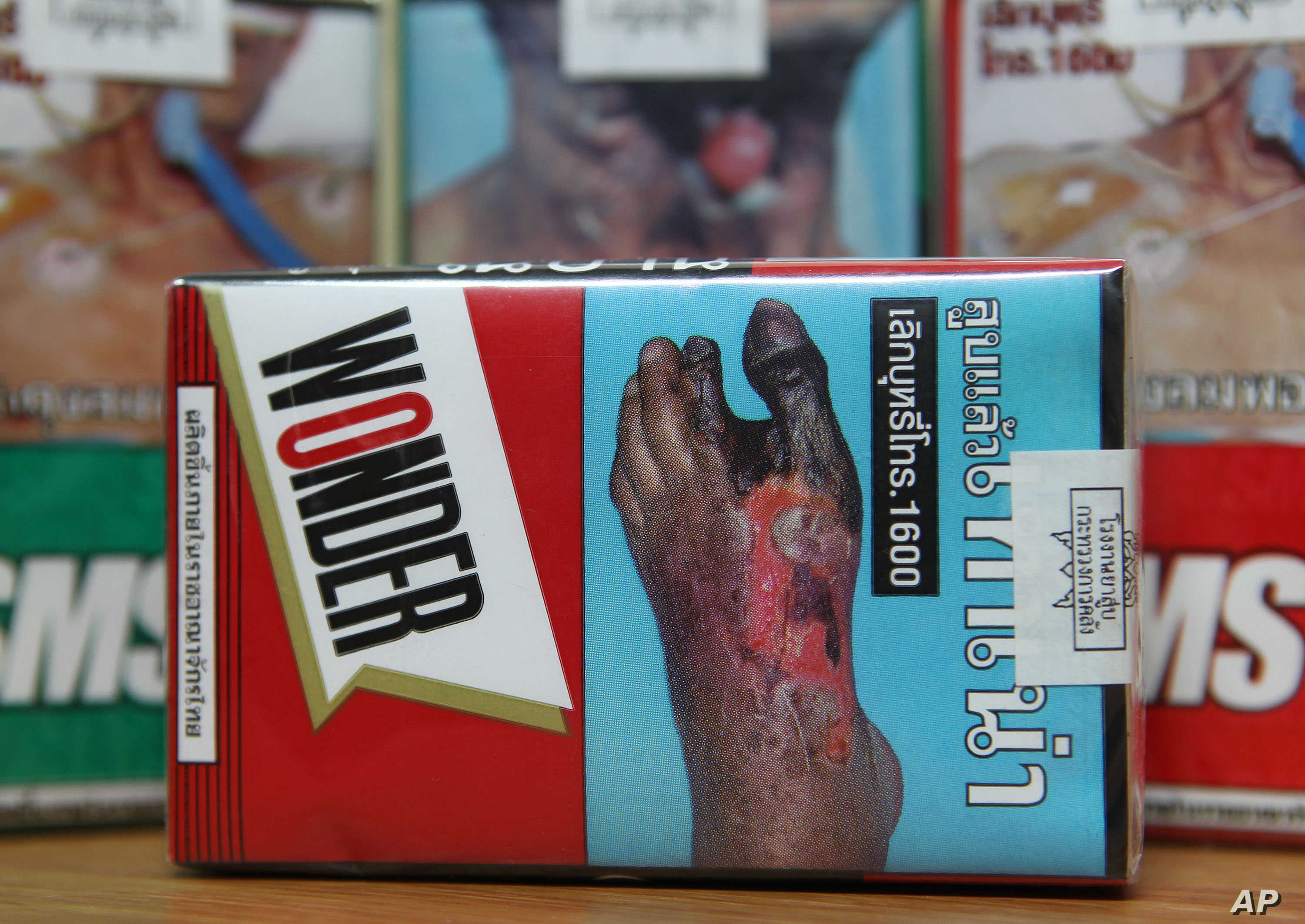 FILE - The warning signs are printed on the cigarette packets on sale in Bangkok, Thailand.