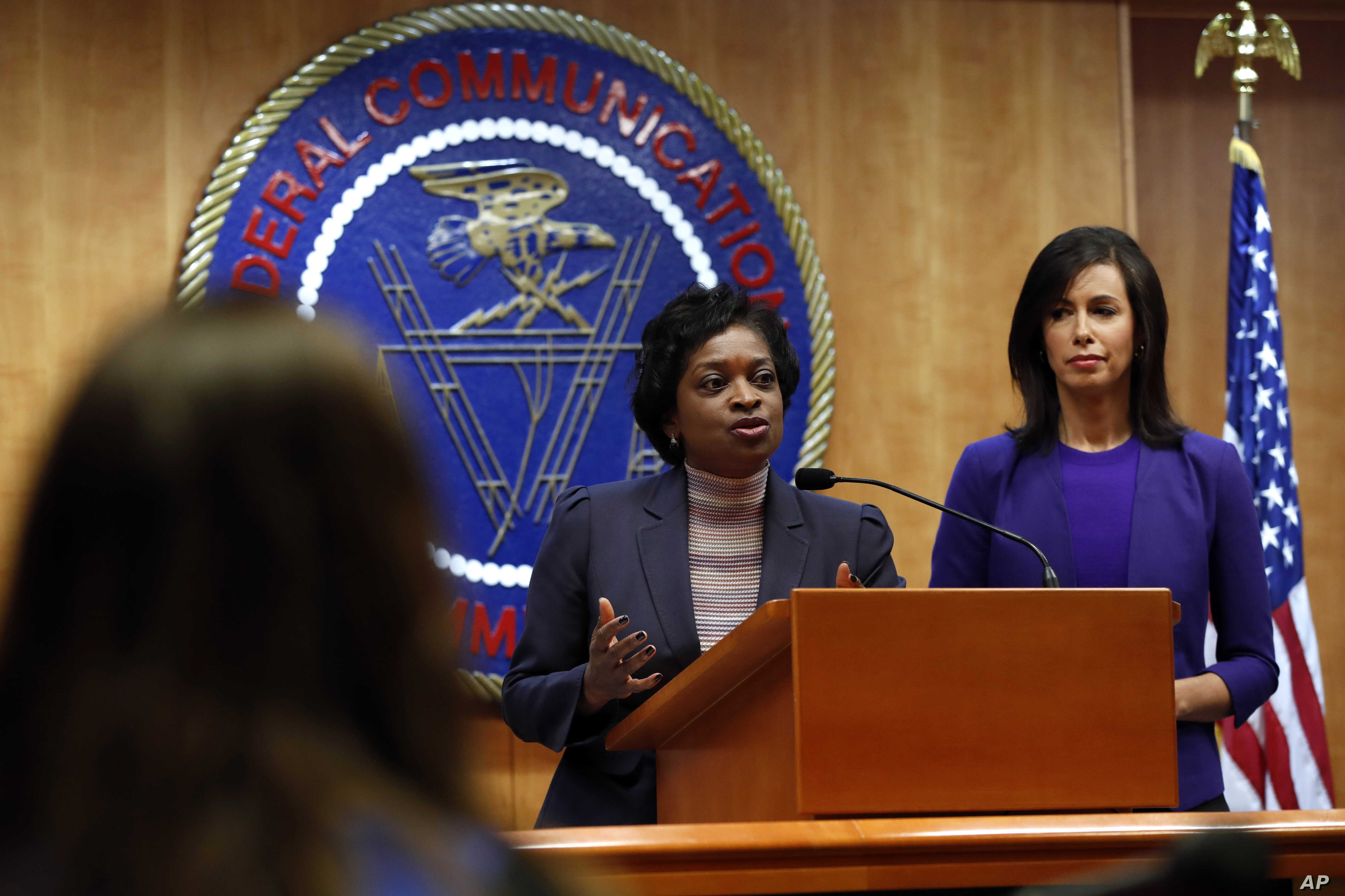Federal Communications Commission (FCC) Commissioners Mignon Clyburn (L) and Jessica Rosenworcel, answer a question from the media after an FCC meeting to vote on net neutrality, Dec. 14, 2017, in Washington.