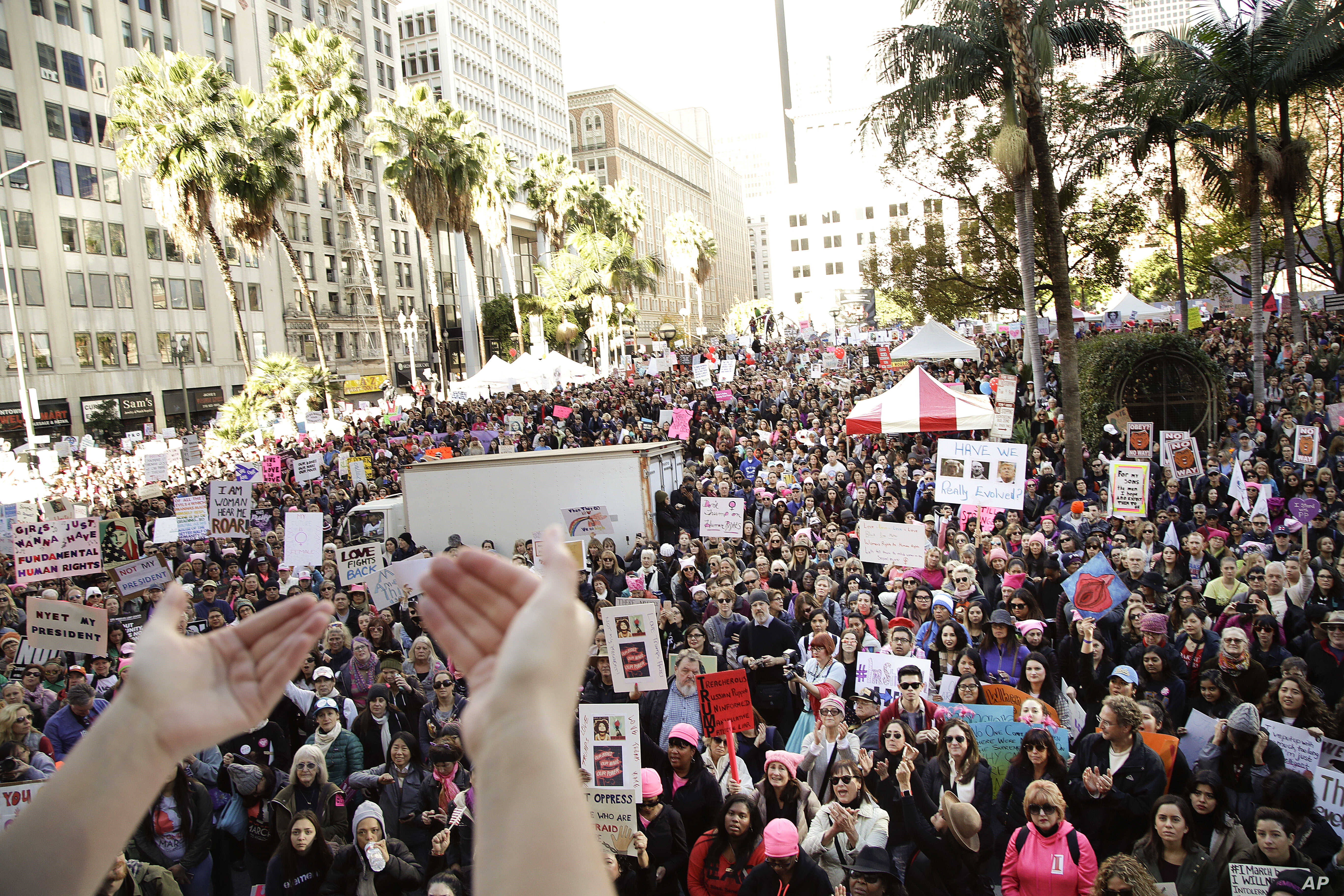 Protesters listen to a speaker as they gather for the Women's March against President Donald Trump, Jan. 21, 2017, in Los Angeles.