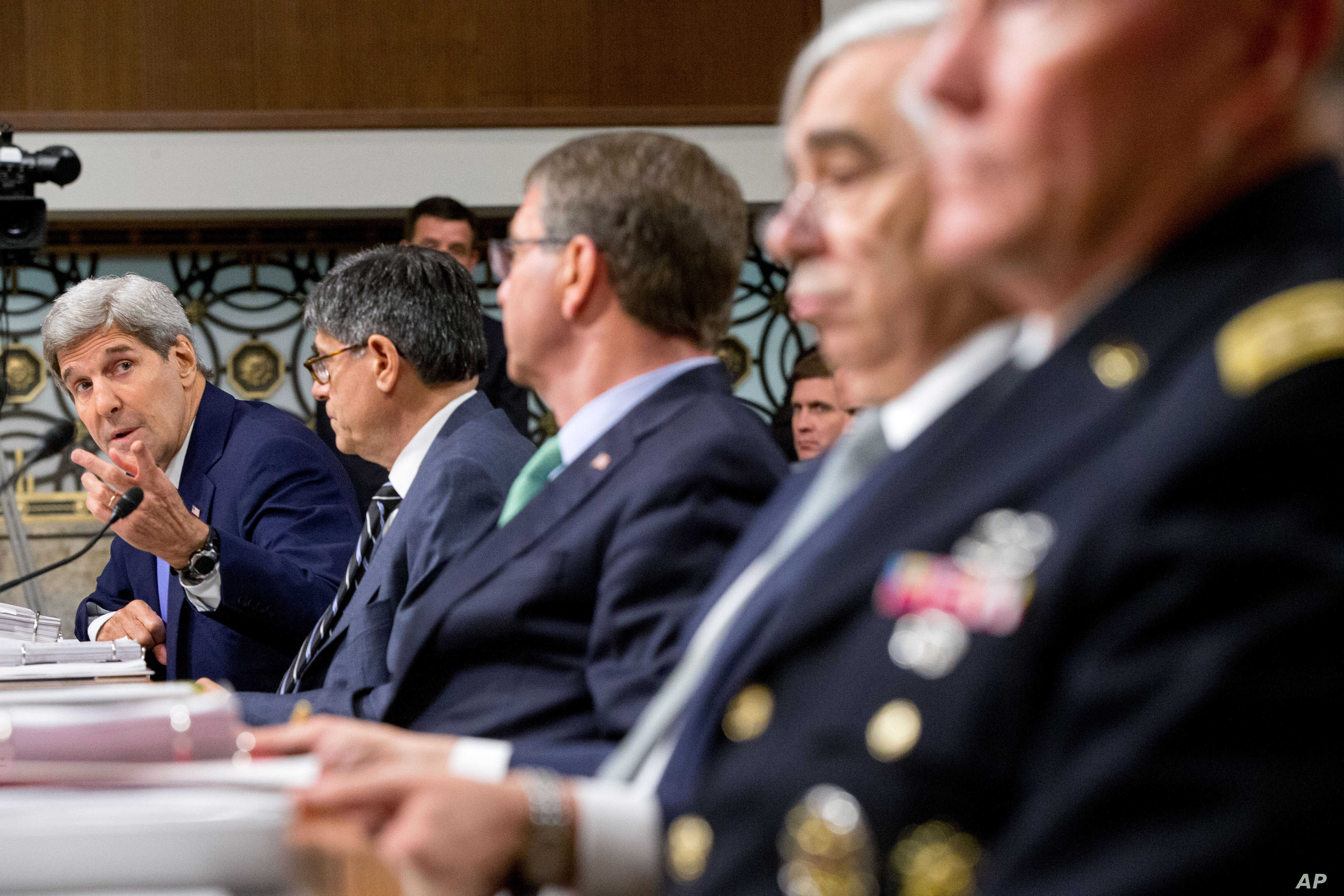 From left, Secretary of State John Kerry, Treasury Secretary Jacob Lew, Defense Secretary Ash Carter, Energy Secretary Ernest Moniz and Joint Chiefs Chairman Gen. Martin Dempsey testify on Capitol Hill in Washington, July 29, 2015.