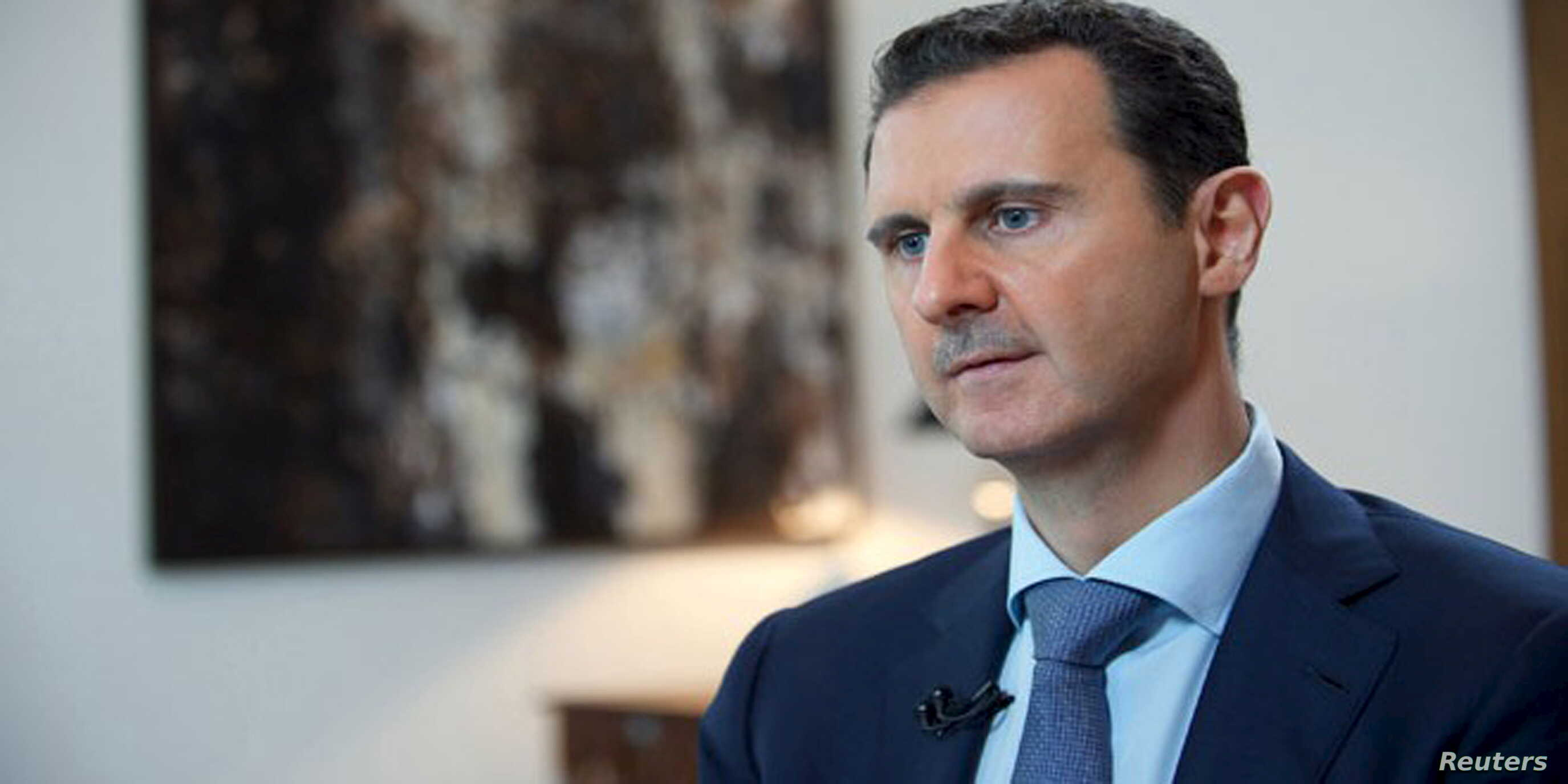 Syria's President Bashar al-Assad speaks during an interview with the Iranian Khabar TV channel in this handout photograph released by Syria's national news agency SANA, Oct. 4, 2015.