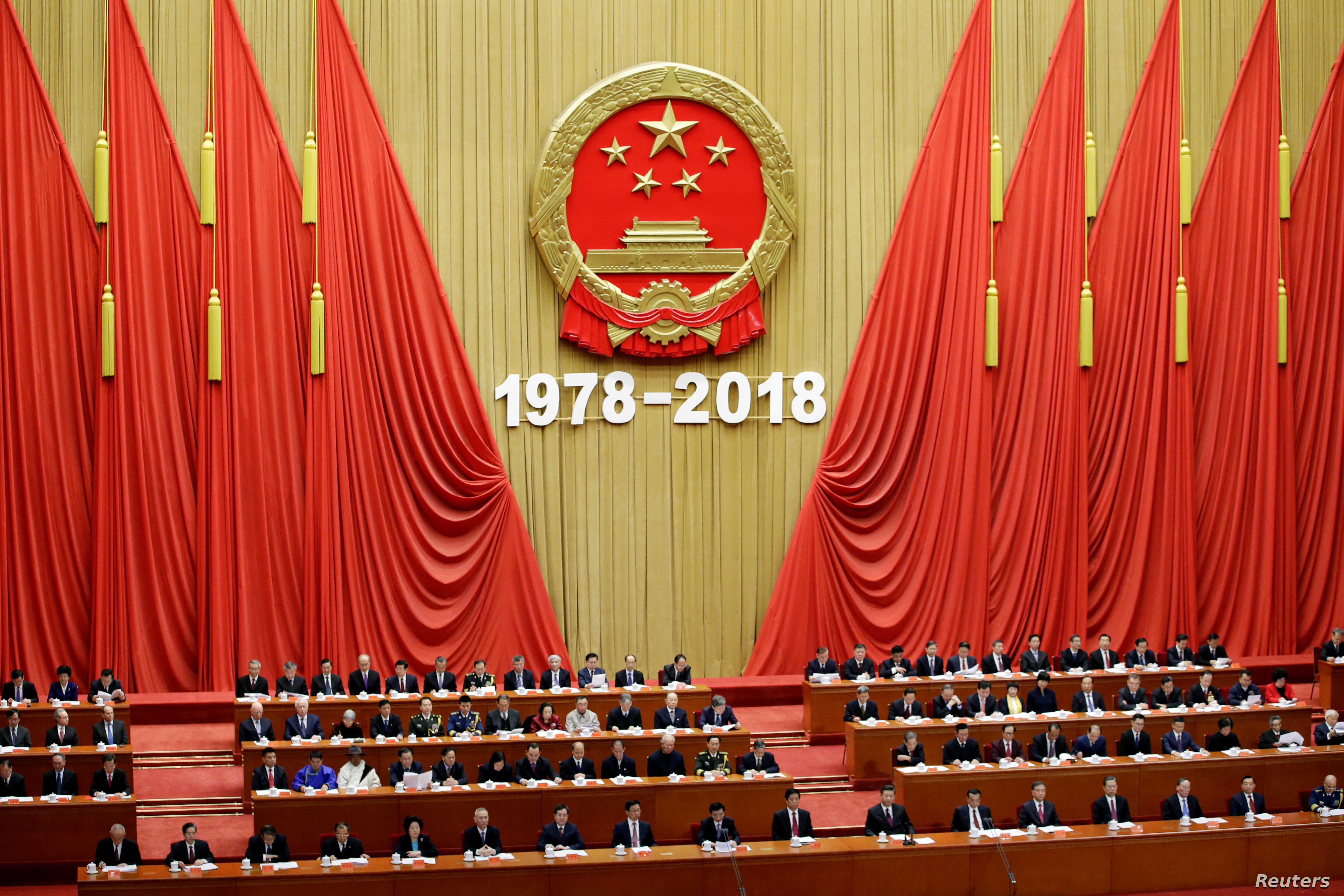 Chinese President Xi Jinping and others attend an event marking the 40th anniversary of China's reform and opening up at the Great Hall of the People in Beijing, China, Dec. 18, 2018.