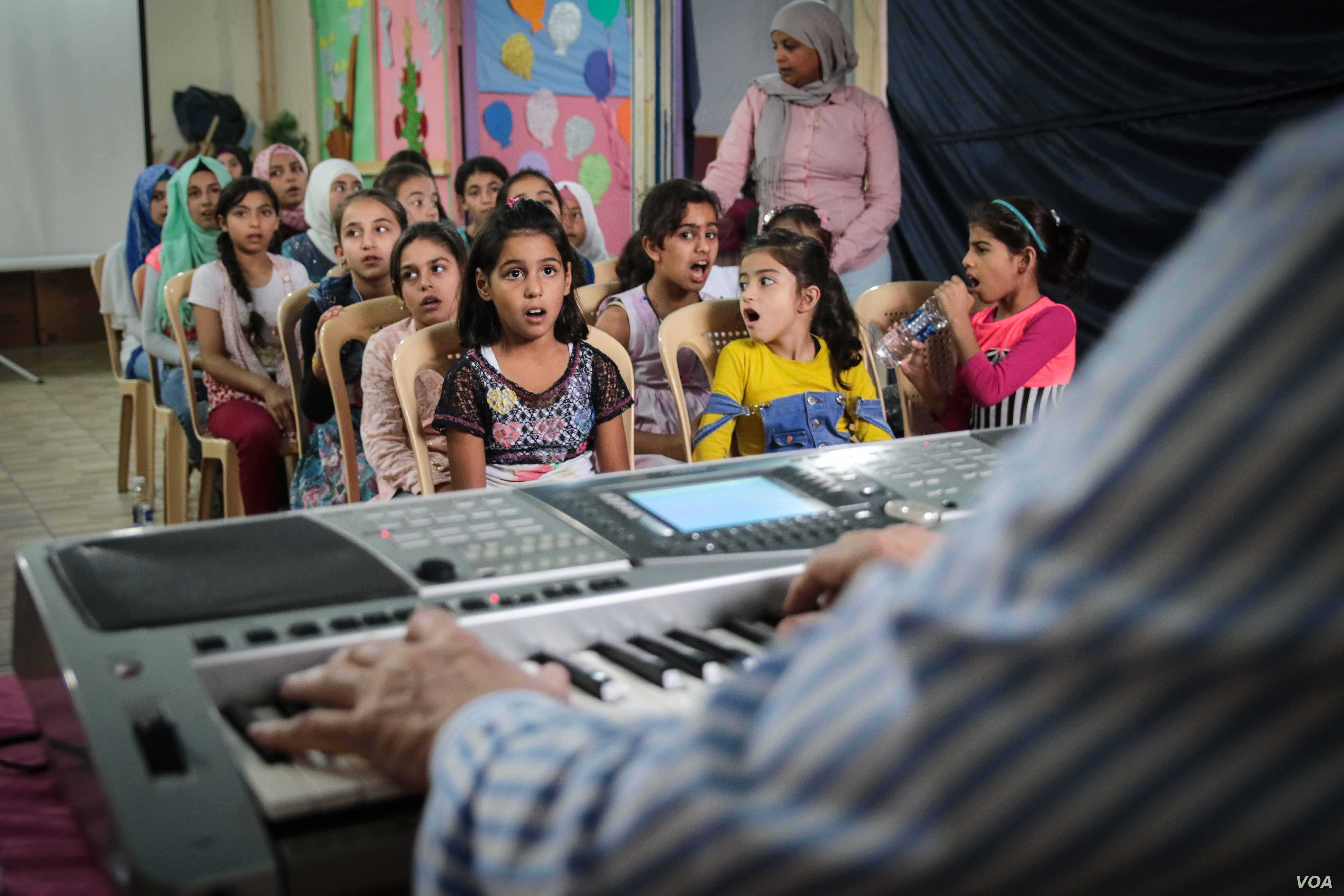 This group is one of five that meets with Salim Sahab and will eventually make up a choir of 300 underprivileged children, Tripoli, Lebanon, Oct. 28, 2017. Sahab began by auditioning about 2,000 children.