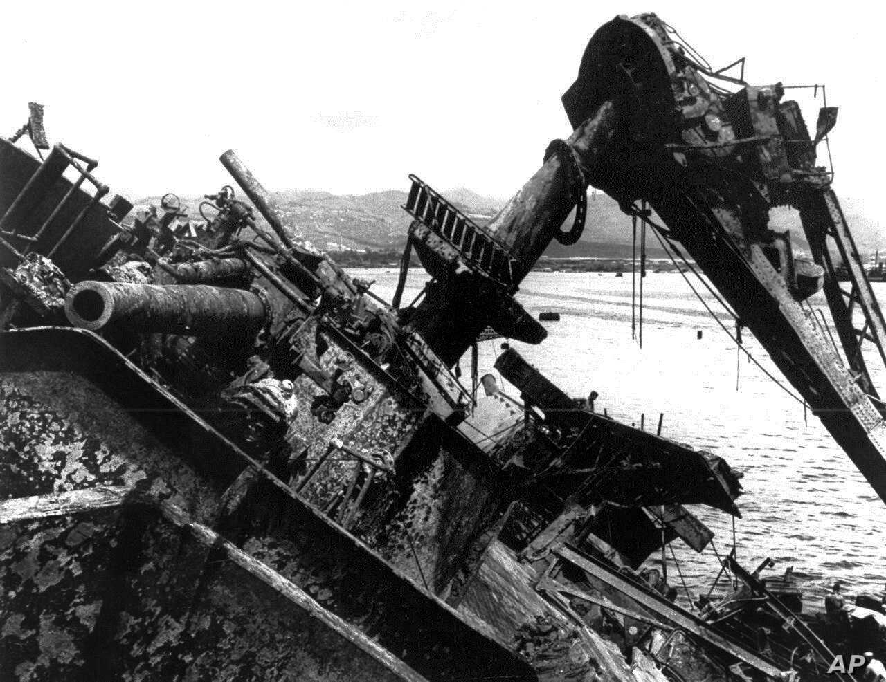 FILE - In this May 24, 1943 file photo, the capsized battleship USS Oklahoma is lifted out of the water at Pearl Harbor in Honolulu, Hawaii.