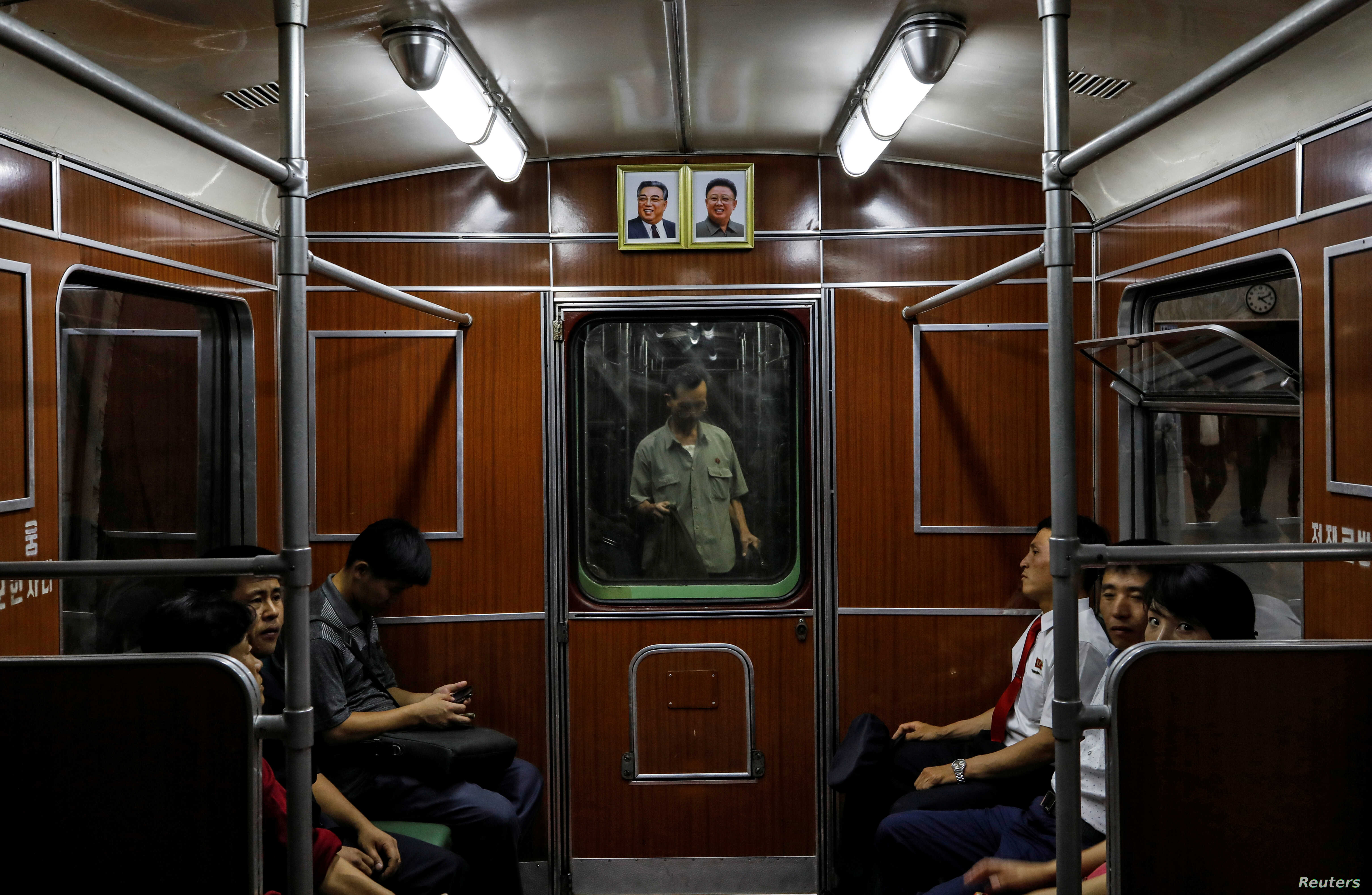 FILE - Portraits of late North Korean leaders Kim Il Sung and Kim Jong Il are seen on a train as it leaves a subway station in Pyongyang, North Korea, Sept. 11, 2018.