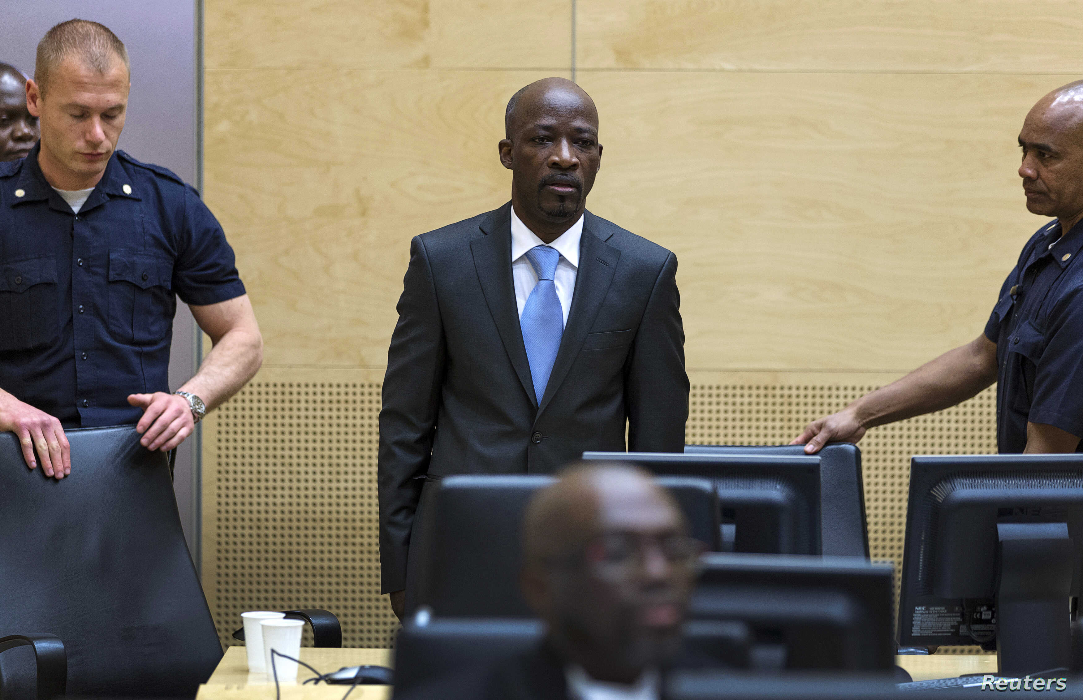 Charles Ble Goude of Ivory Coast enters the courtroom of the International Criminal Court (ICC) for his initial appearance in The Hague, Netherlands, March 27, 2014.