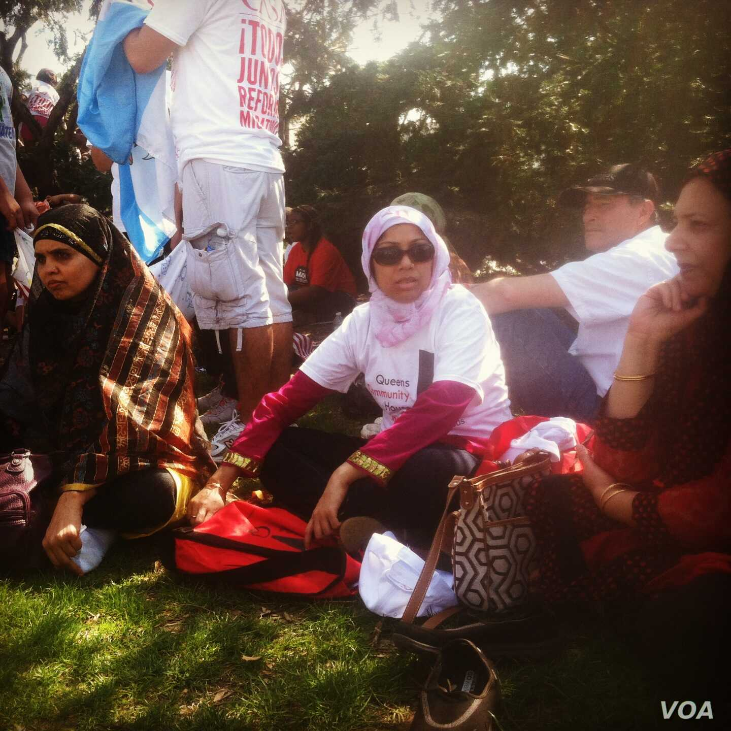 """Bangladeshi-born Farzana Morshed of the Queens Community House sits in the shade on the edge of the """"All in for Citizenship"""" rally at the U.S. Capitol in Washington, DC, Wednesday, April 10, 2013. (Photo by Kate Woodsome)"""