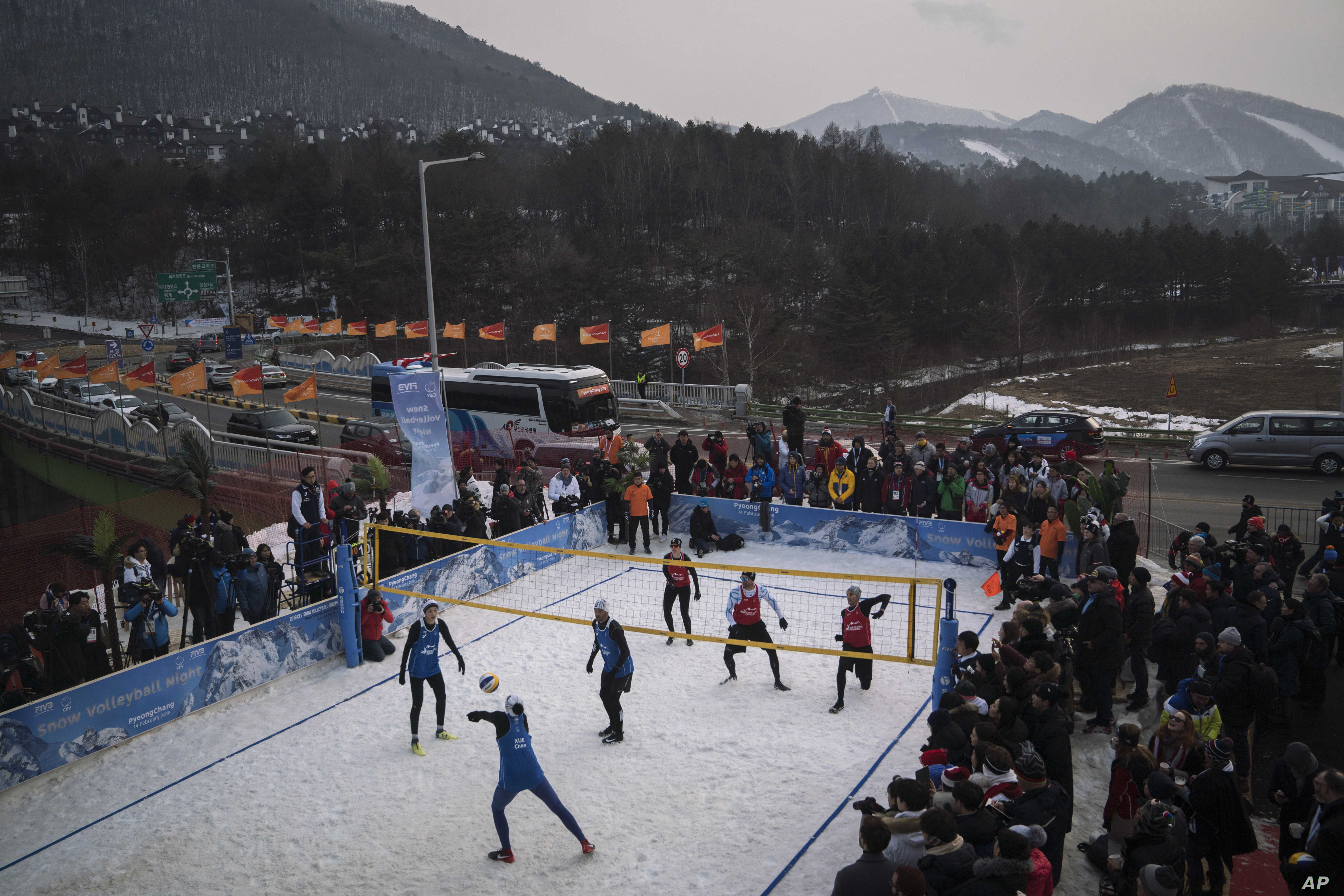 FILE - China's Xue Chen passes the ball during a snow volleyball exhibition match at Austria House in Pyeongchang, South Korea, Feb. 14, 2018.