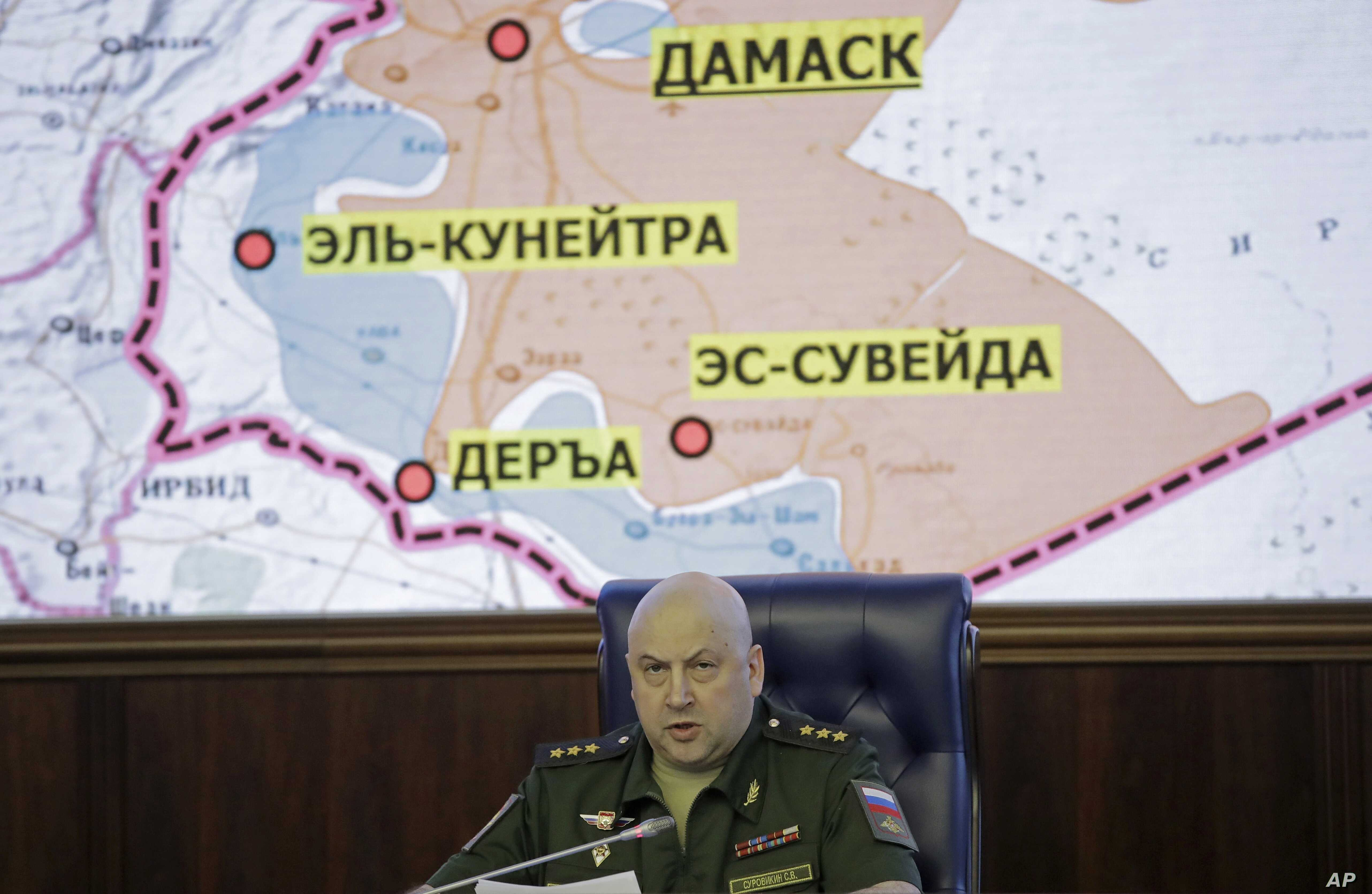 Colonel General Sergei Surovikin, commander of the Russian forces in Syria, speaks, with a map of Syria projected on the screen in the back, at a briefing in the Russian Defense Ministry in Moscow, June 9, 2017.