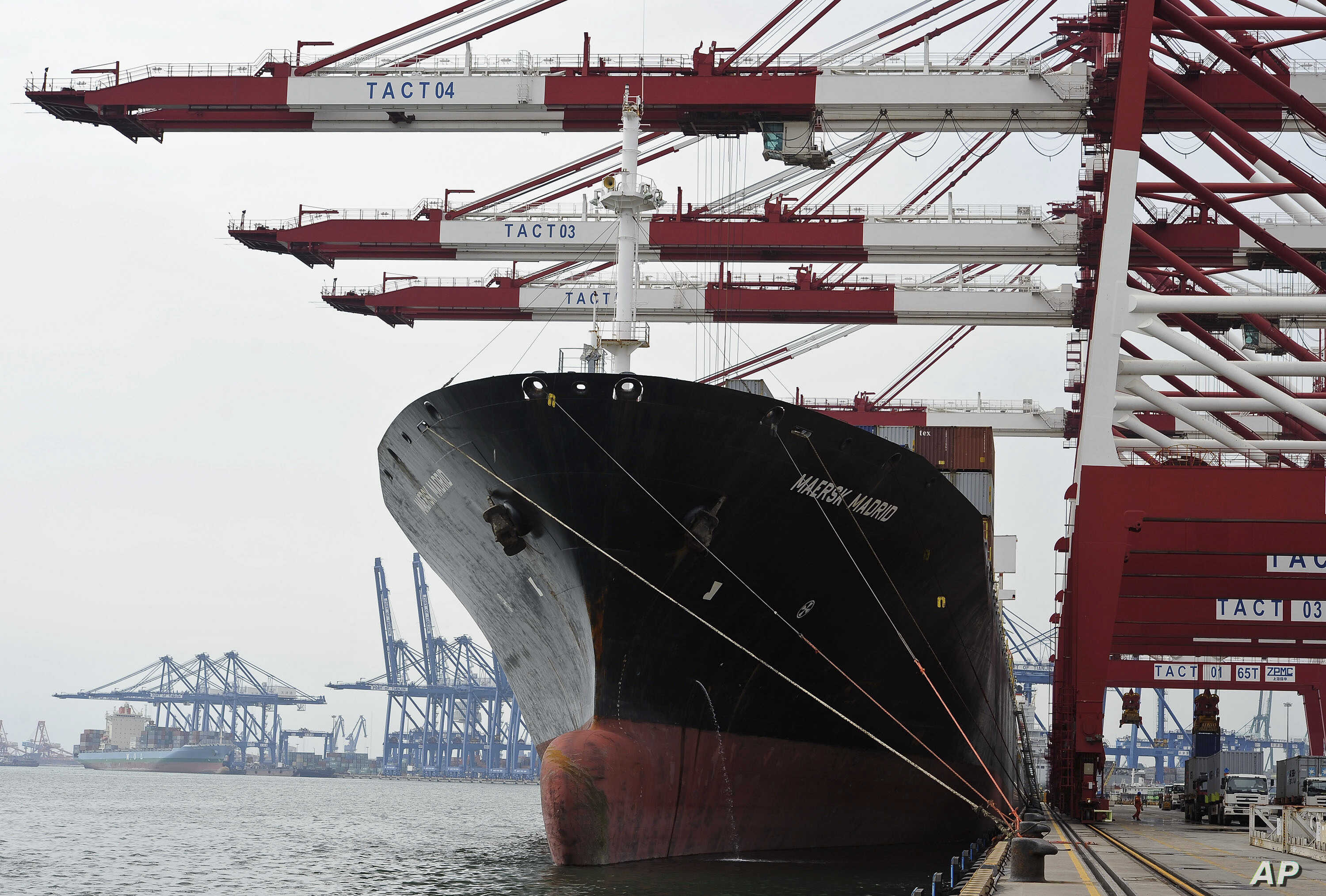 """FILE - Containers are loaded onto a cargo ship at the Tianjin port in China. A Brookings Institution analyst says that if the U.S. doesn't take the lead """"in writing the rules for the economy of East Asia, the Chinese will, and we are not going to lik..."""