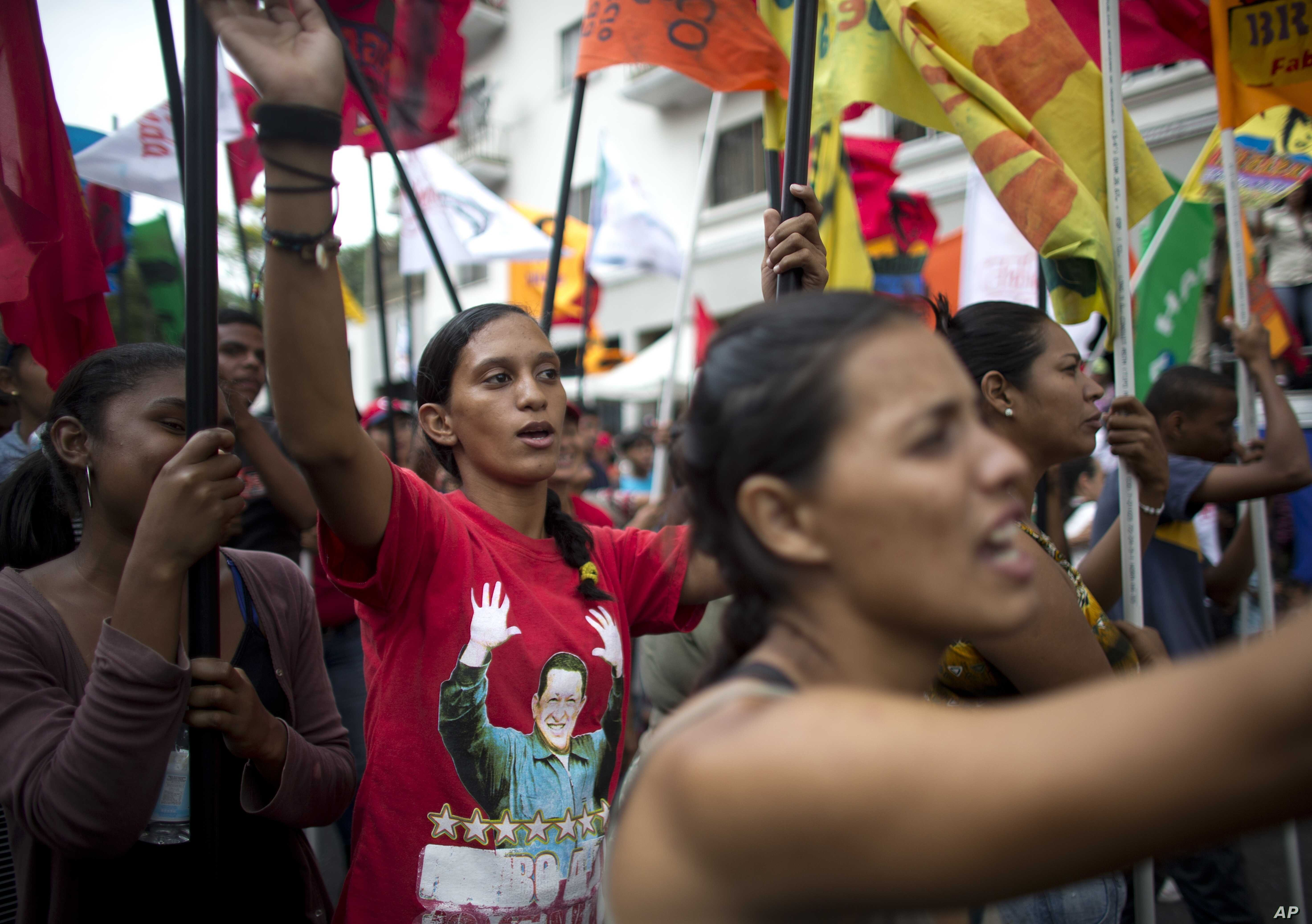 Government supporters march during an anti-imperialist rally in Caracas, Venezuela, Saturday, March 30, 2019.