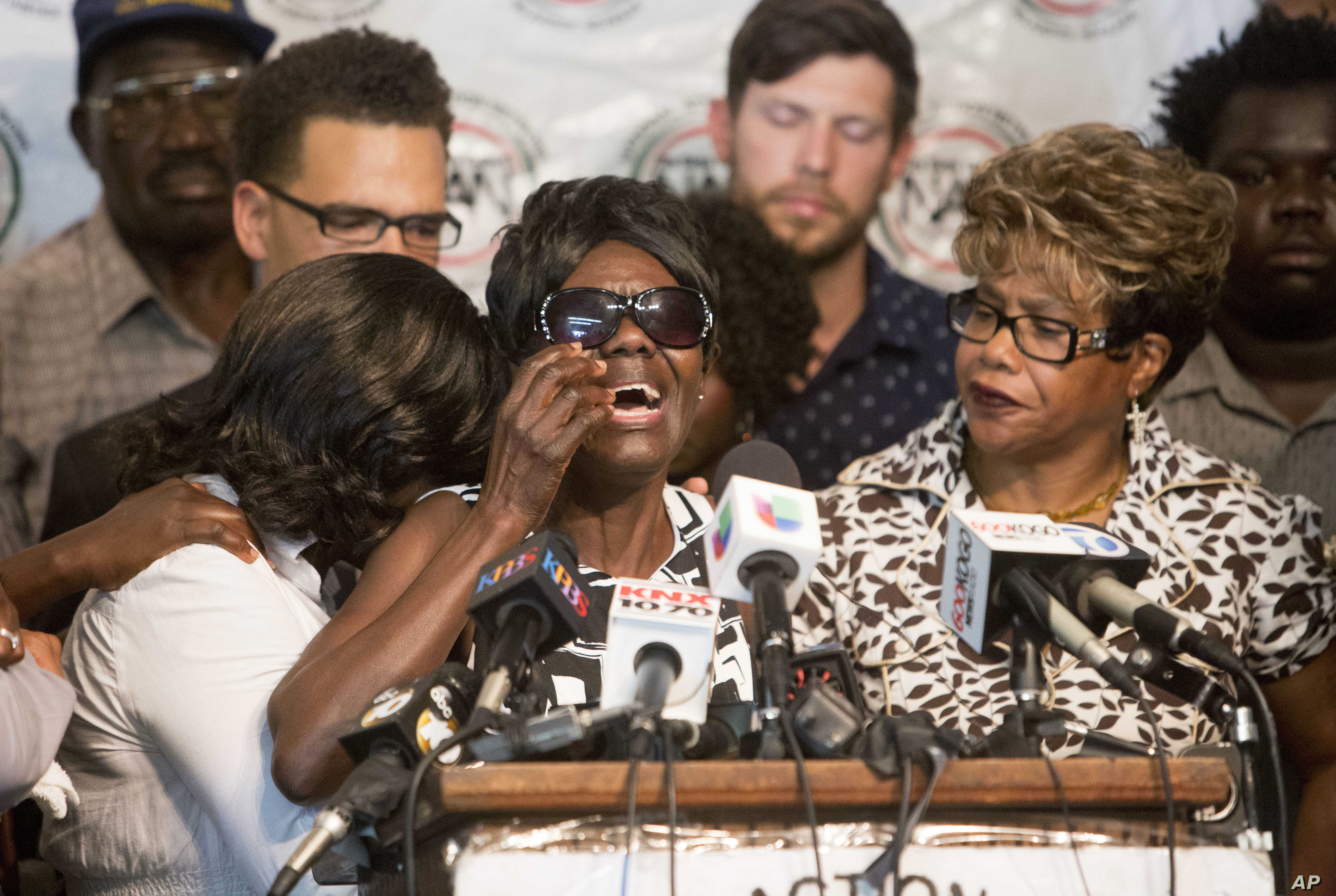 FILE - Pamela Benge, center, spoke of her son, Alfred Olango, at a press conference in San Diego, Calif., Sept. 29, 2016, to address the killing of Olango, a Ugandan refugee shot by an El Cajon police officer two days earlier.