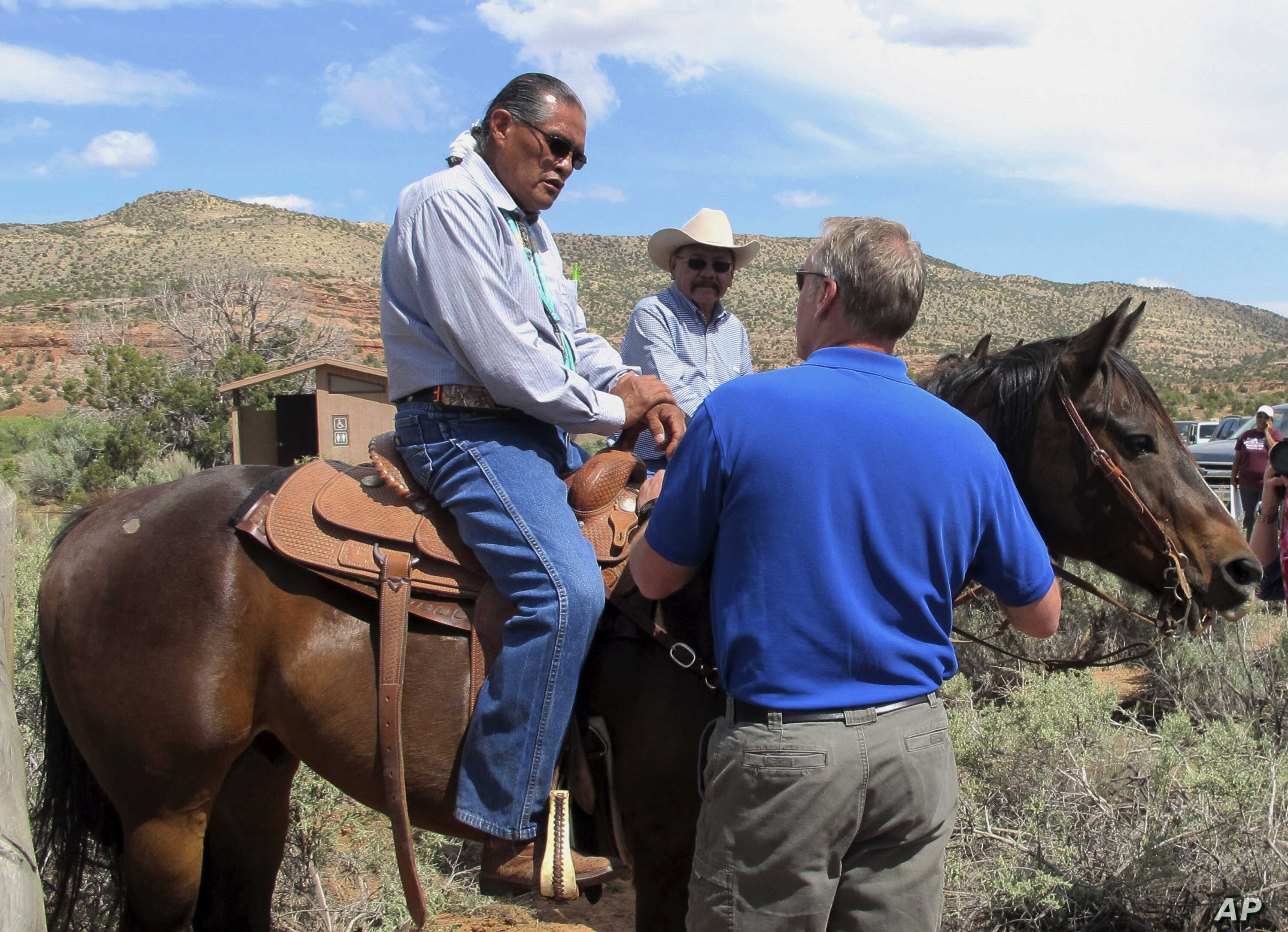Interior Secretary Ryan Zinke, right, talks with two men on horses, May 8, 2017, at the Butler Wash trailhead within Bears Ears National Monument near Blanding, Utah.