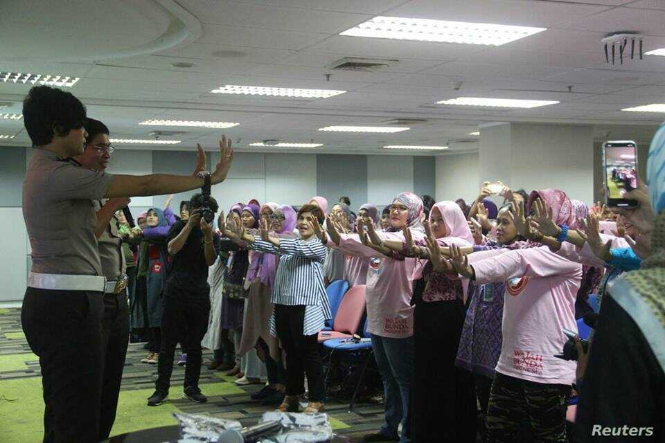 Queenrides women members take part in a workshop in Indonesia.