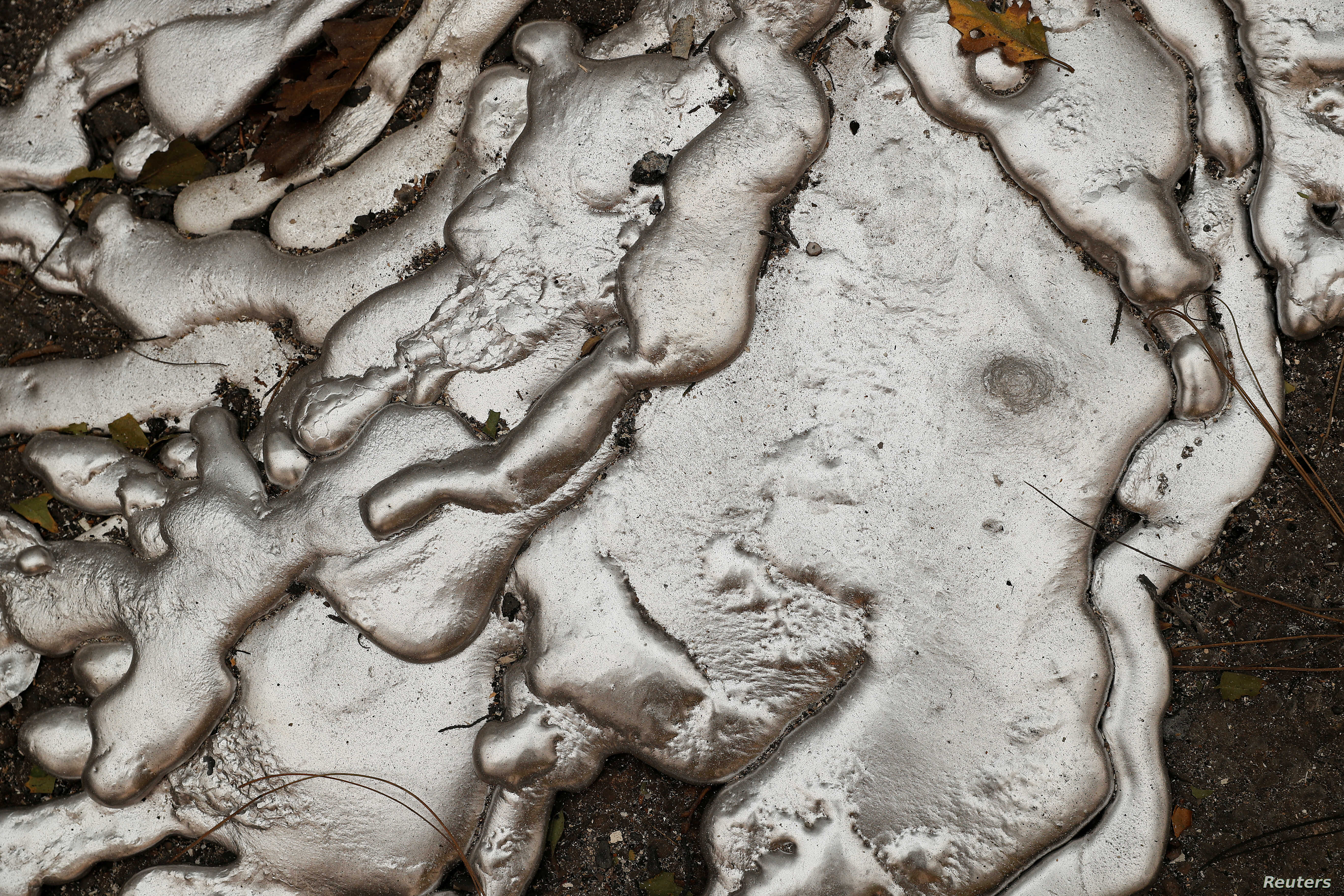 Melted metal from an abandoned car destroyed by the Camp Fire is seen in Paradise, California, U.S., Nov. 10, 2018.